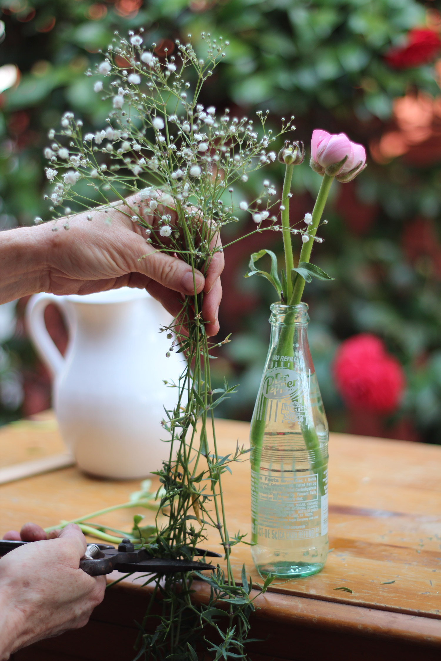 Next measure the baby's breath and cut. It should be a couple of inches higher than the ranunculus.