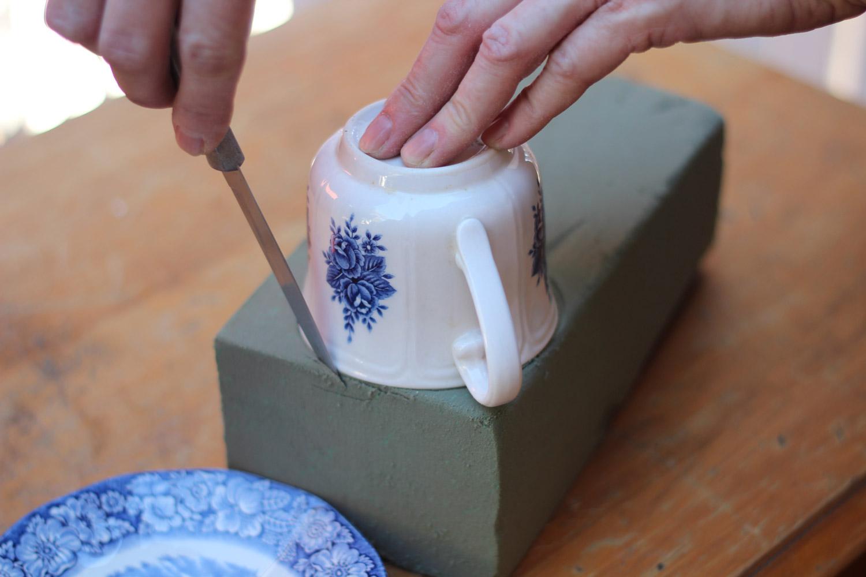 Cut foam smaller than diameter of cup so it fits snugly inside.