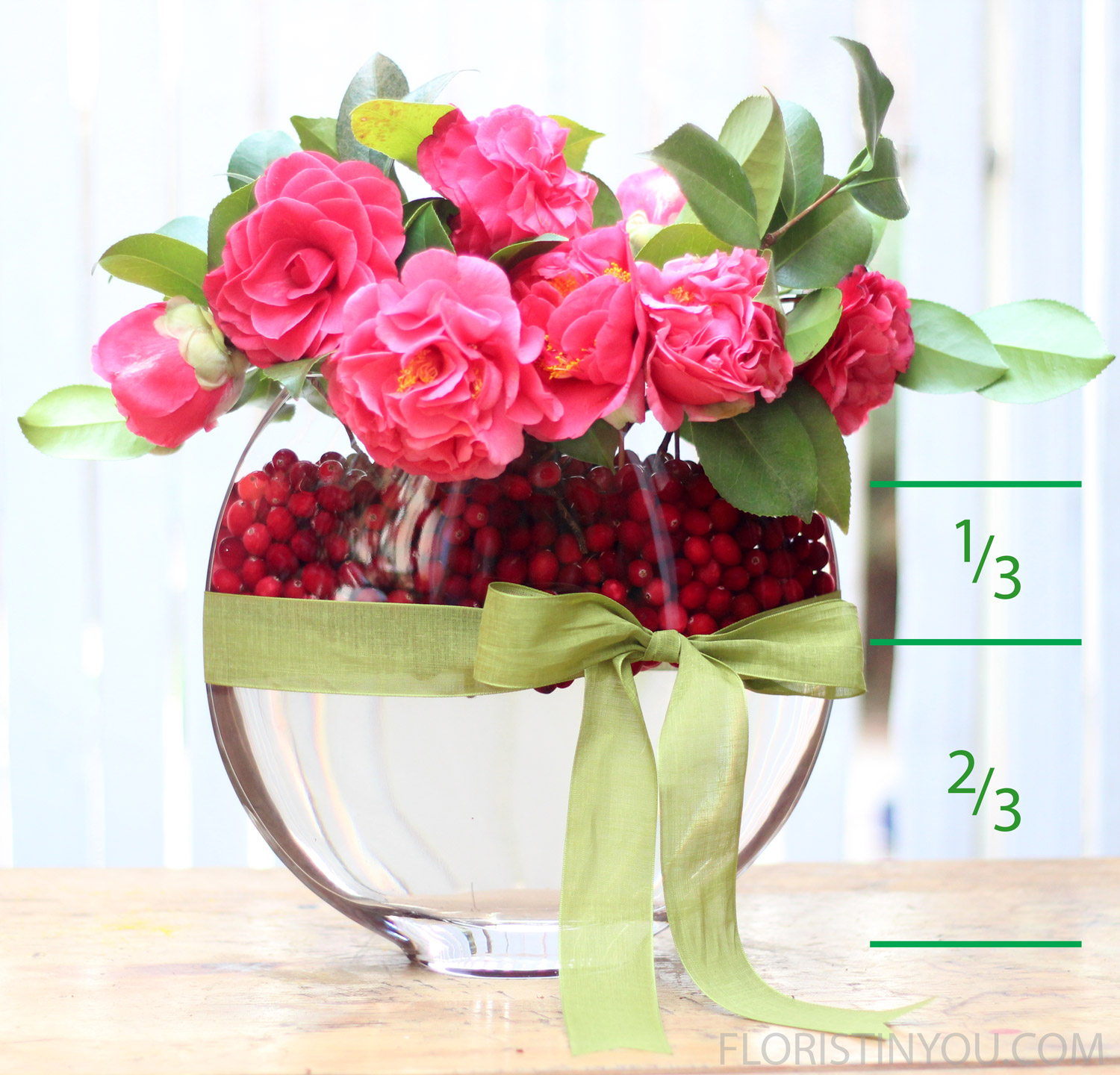 The cranberries take up about 1/3 of the vase.