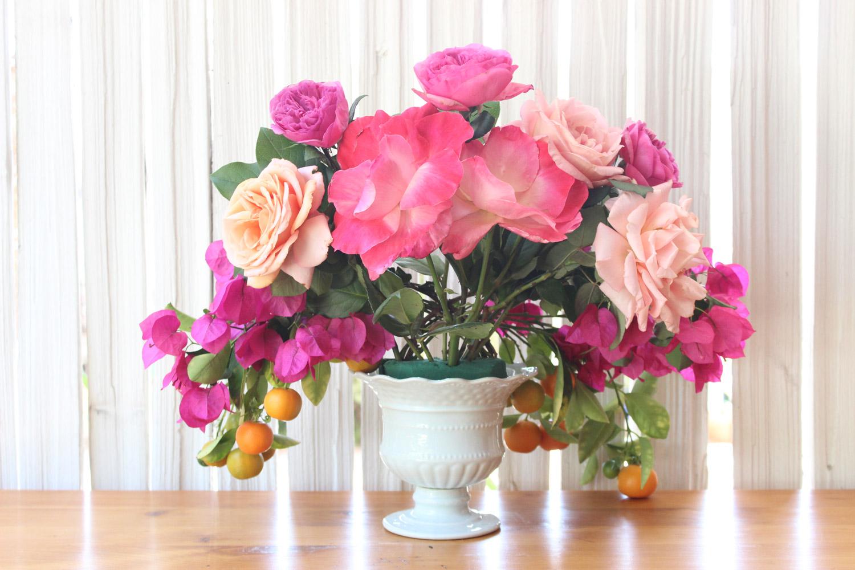Add 2 orange roses (lower than the Gemini)