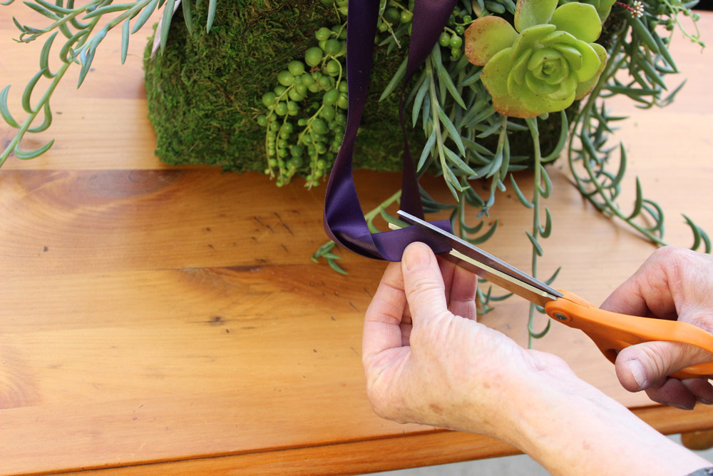 Fold ends in half andcut ribbon at 45 degree angle.
