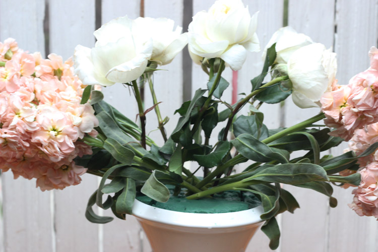"""Insert 5 white roses that are cut 11"""" long for center, 10.5"""" sides, and 9.25"""" by the rim."""