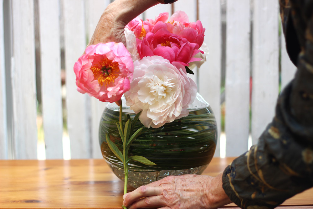 """Cut large flower at 10"""". Place low in center as focal point. Measure  next cut."""