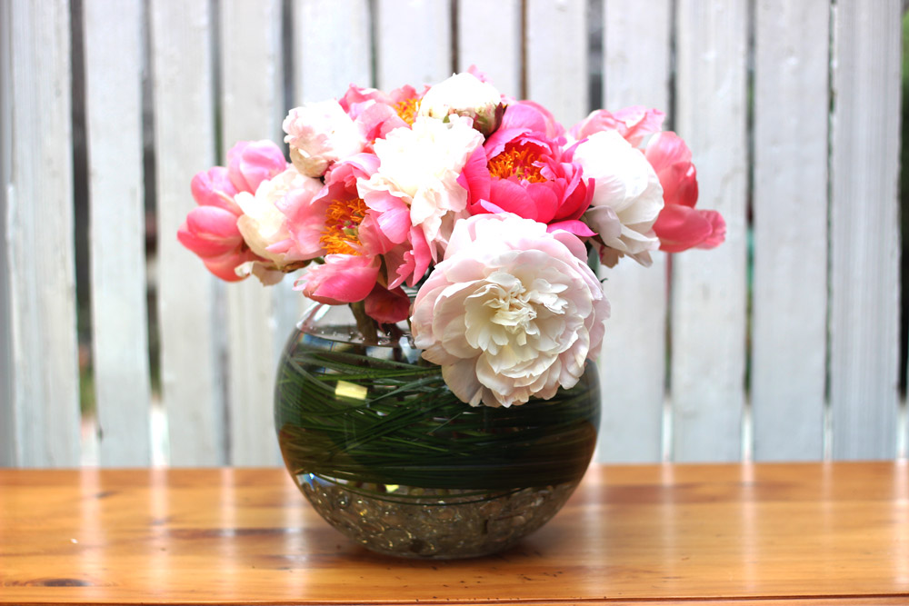 Place blush peonies on both sides and add buds in center.