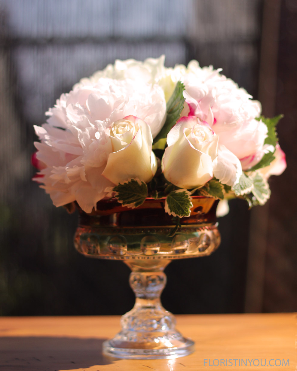 The Ruby Red Band Vase uses 1 hydrangea, 2 peony, and 4 - 6 roses.