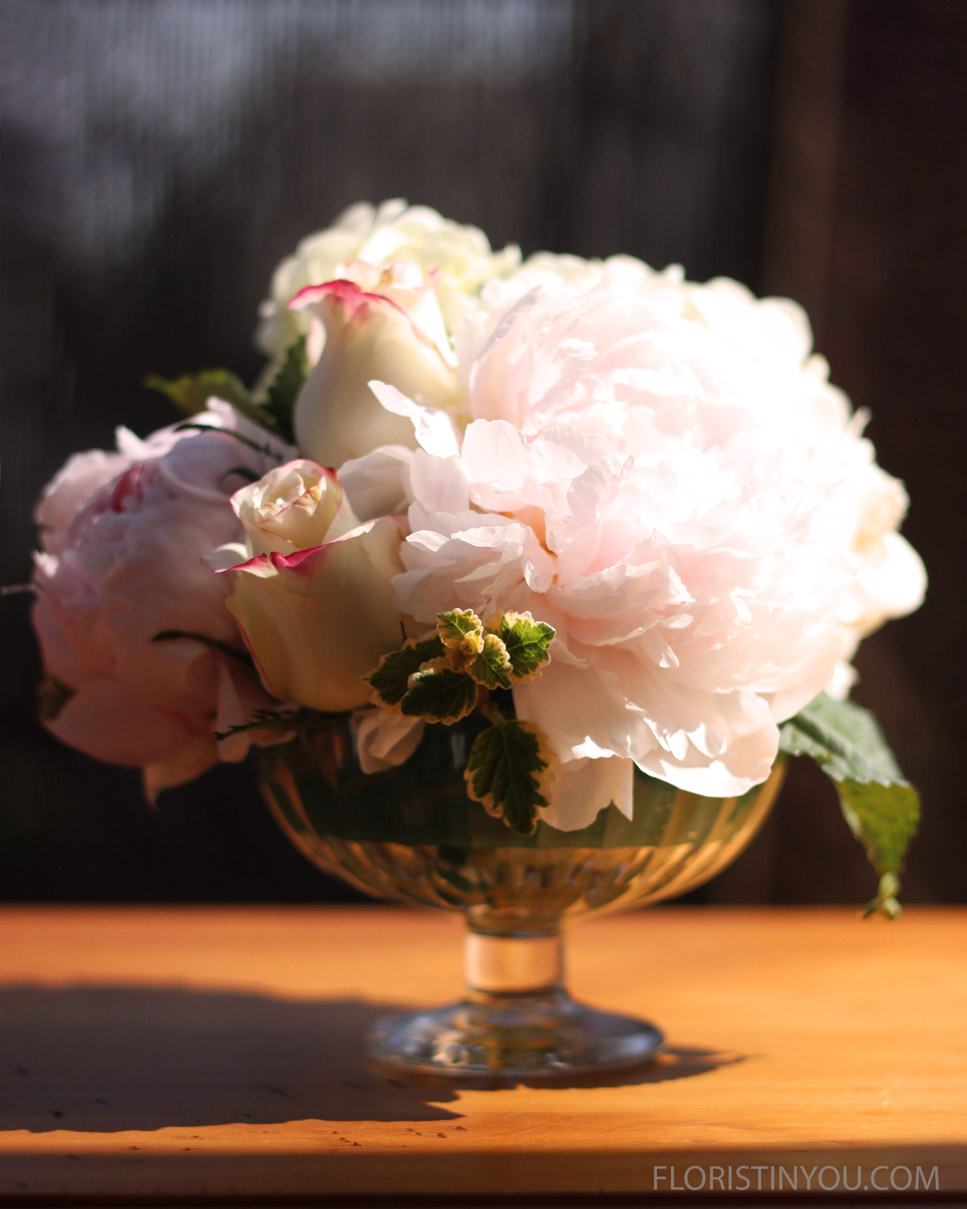 The Ribbed Vaseuses 1 hydrangea, 2 peony, and 4 - 6 roses.