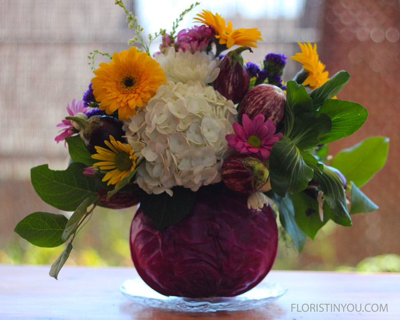 Add picks in the front and back. Add yellow Gerbers, purple Cosmos, and yellow Daisies.