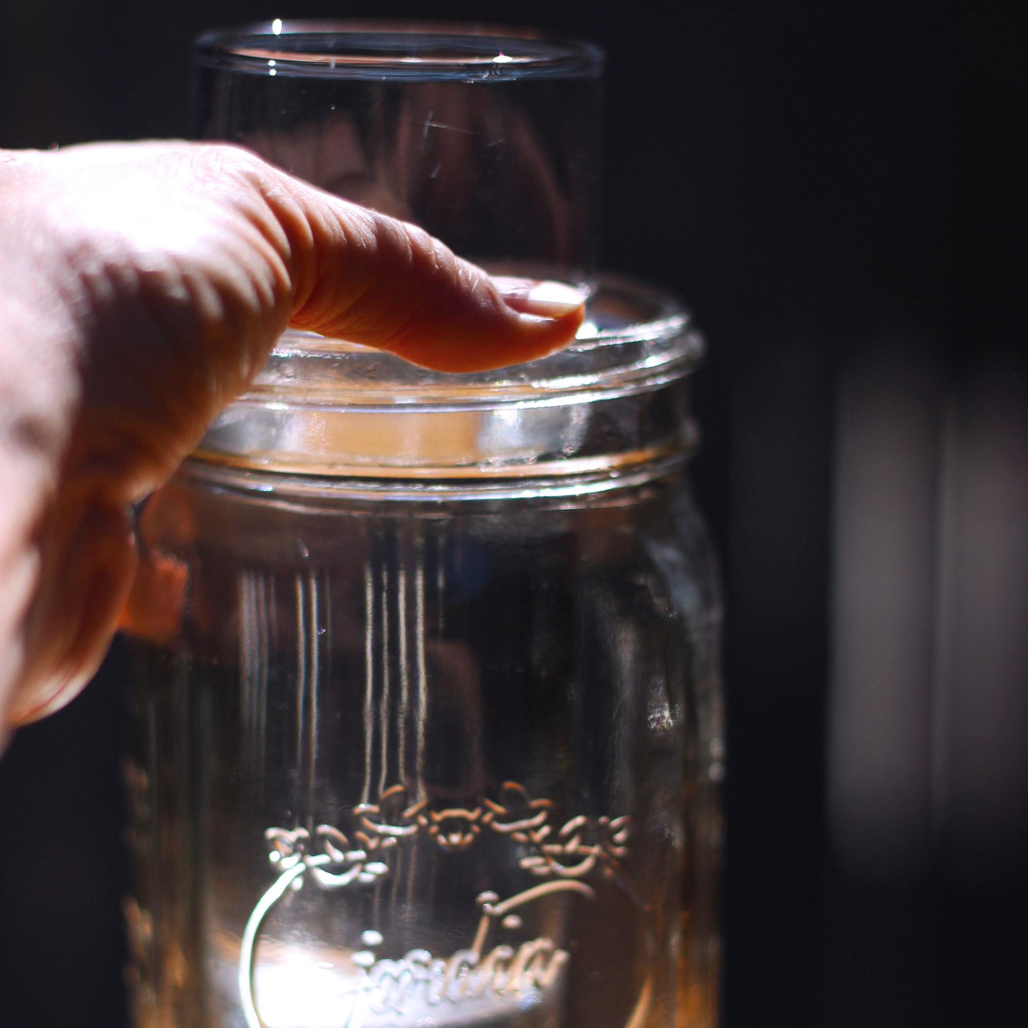 "Now insert vase into the ""Mason jar"", like so."