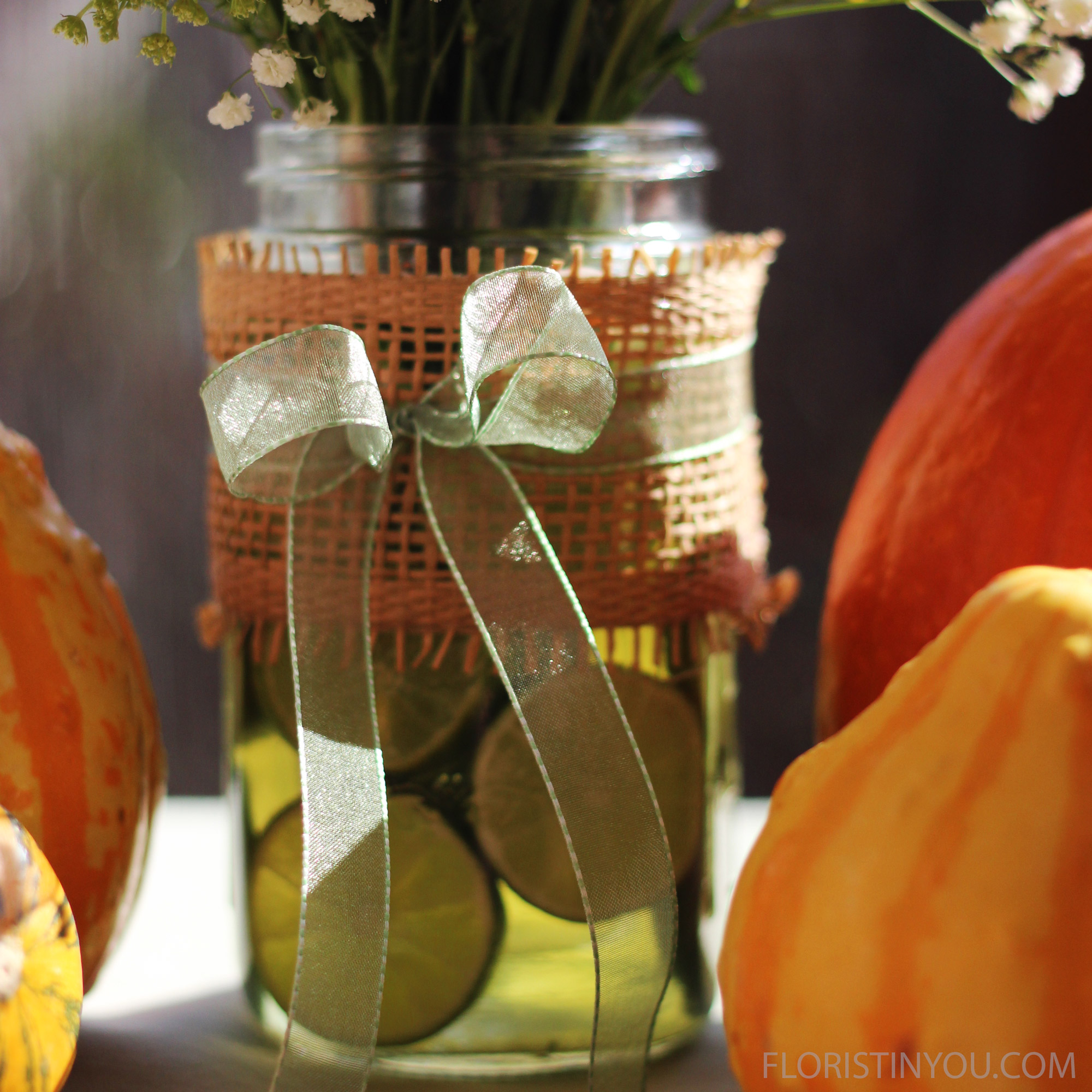 Tie the green ribbon with a bow in front around the jar.