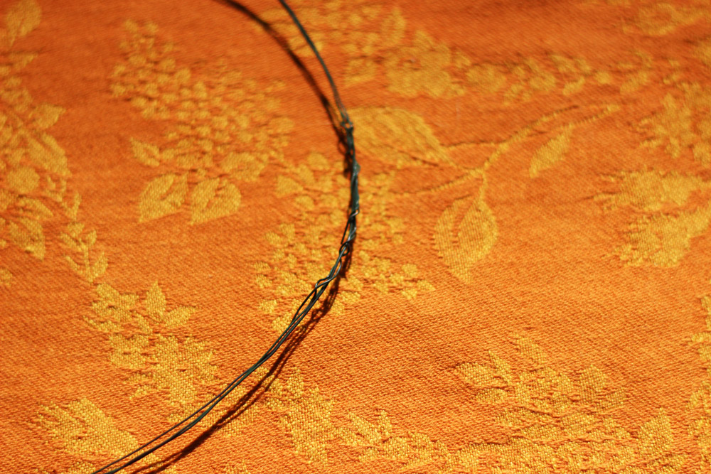Wrap the ends around the wire oval so there are no sharp edges.