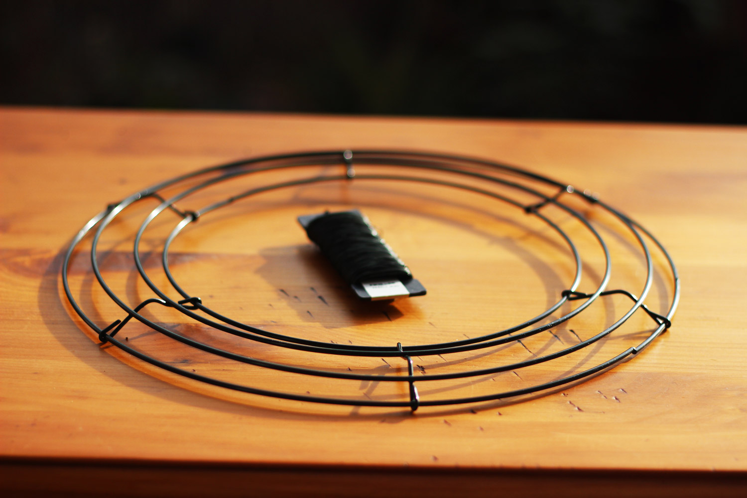 Buy a 12 inch wire frame and you will use part of a paddle of 26 gauge wire.