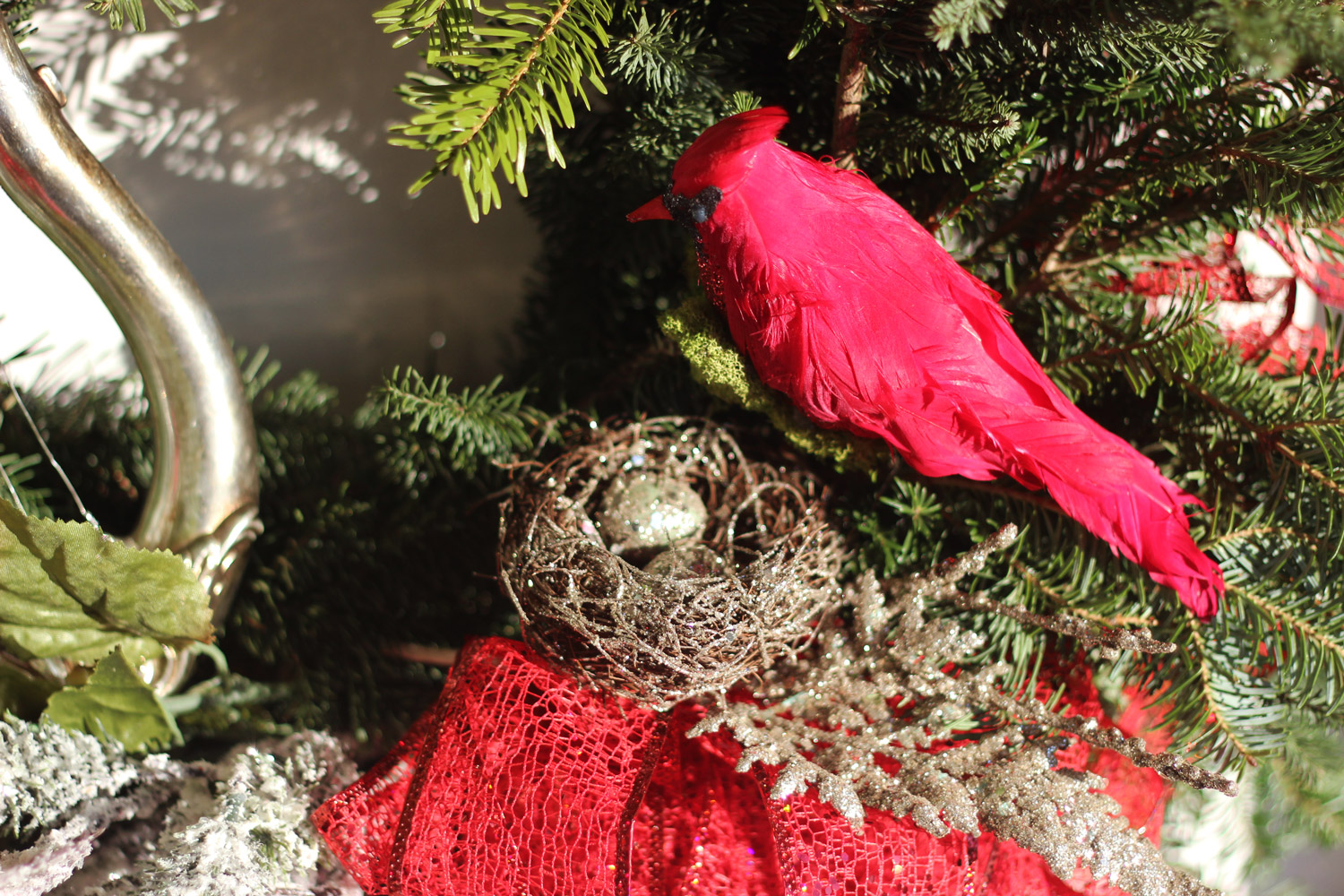 Ah, here's a   beautiful silvery nest with two eggs for the bird to watch. Attach the nest.