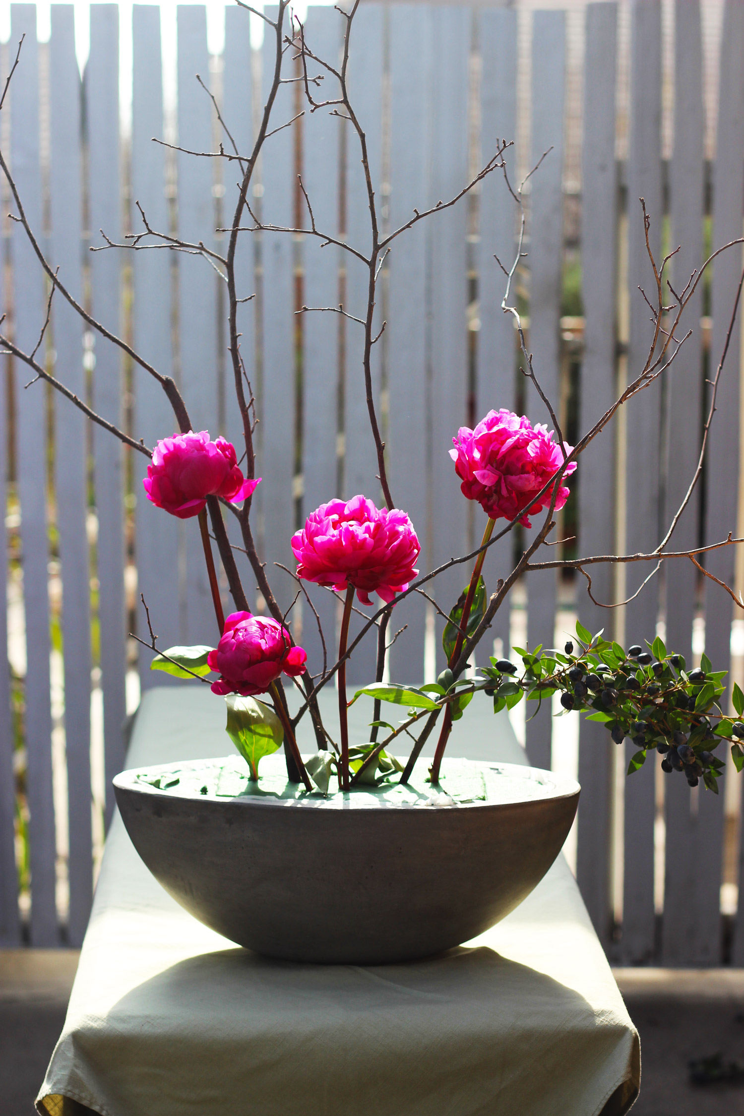 Place Peonies. Follow the placements shown. Place blue berry branch curving on a low angle to the right.