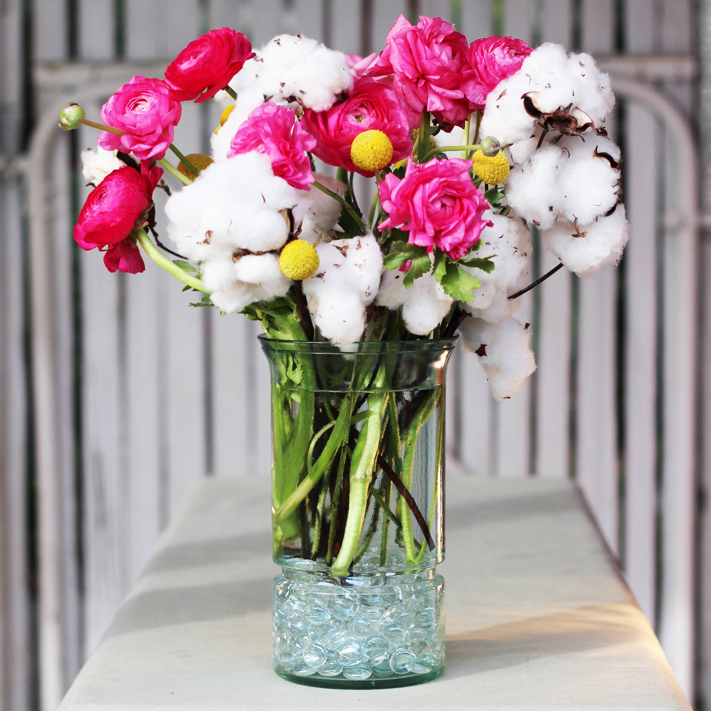 Add the pink Ranunculus.