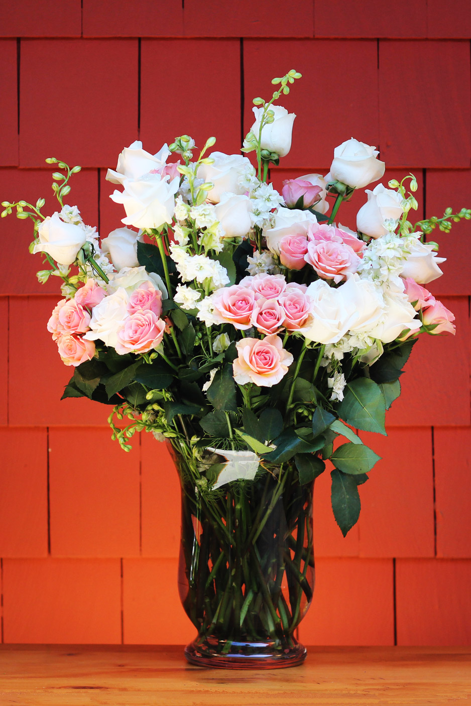 Add pink spray roses, taller in center, shorter in the front.