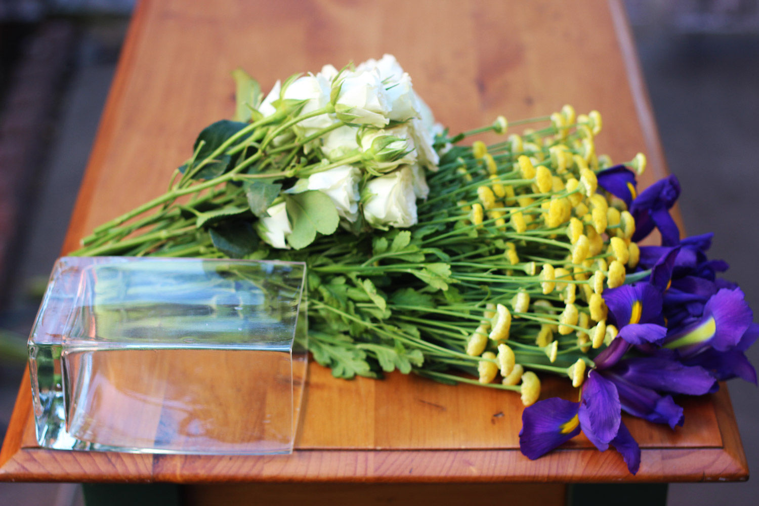 Lay your flowers out how they will stand in the vase and cut the stems.
