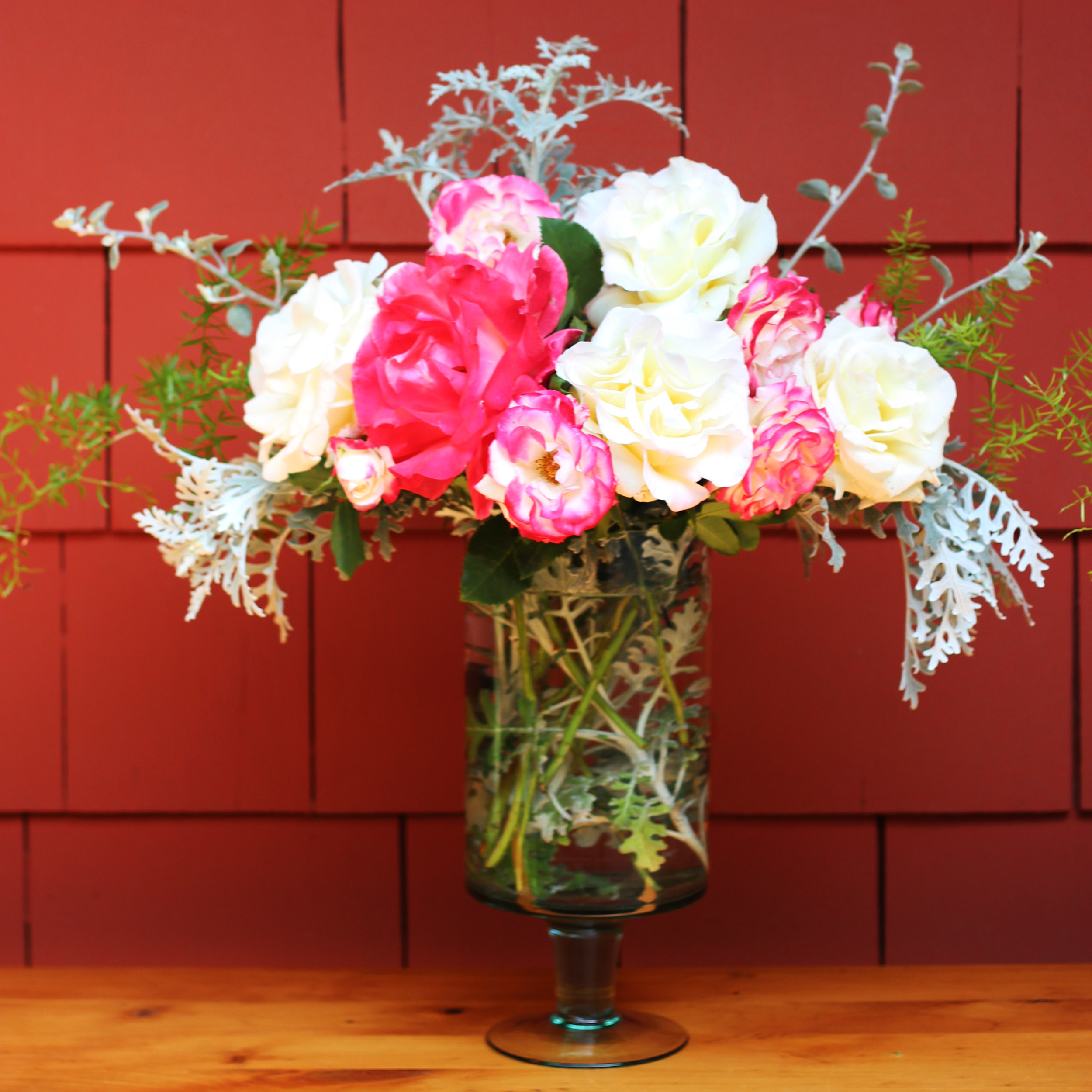 Add focal point flower (fuchsia rose) to lower left.