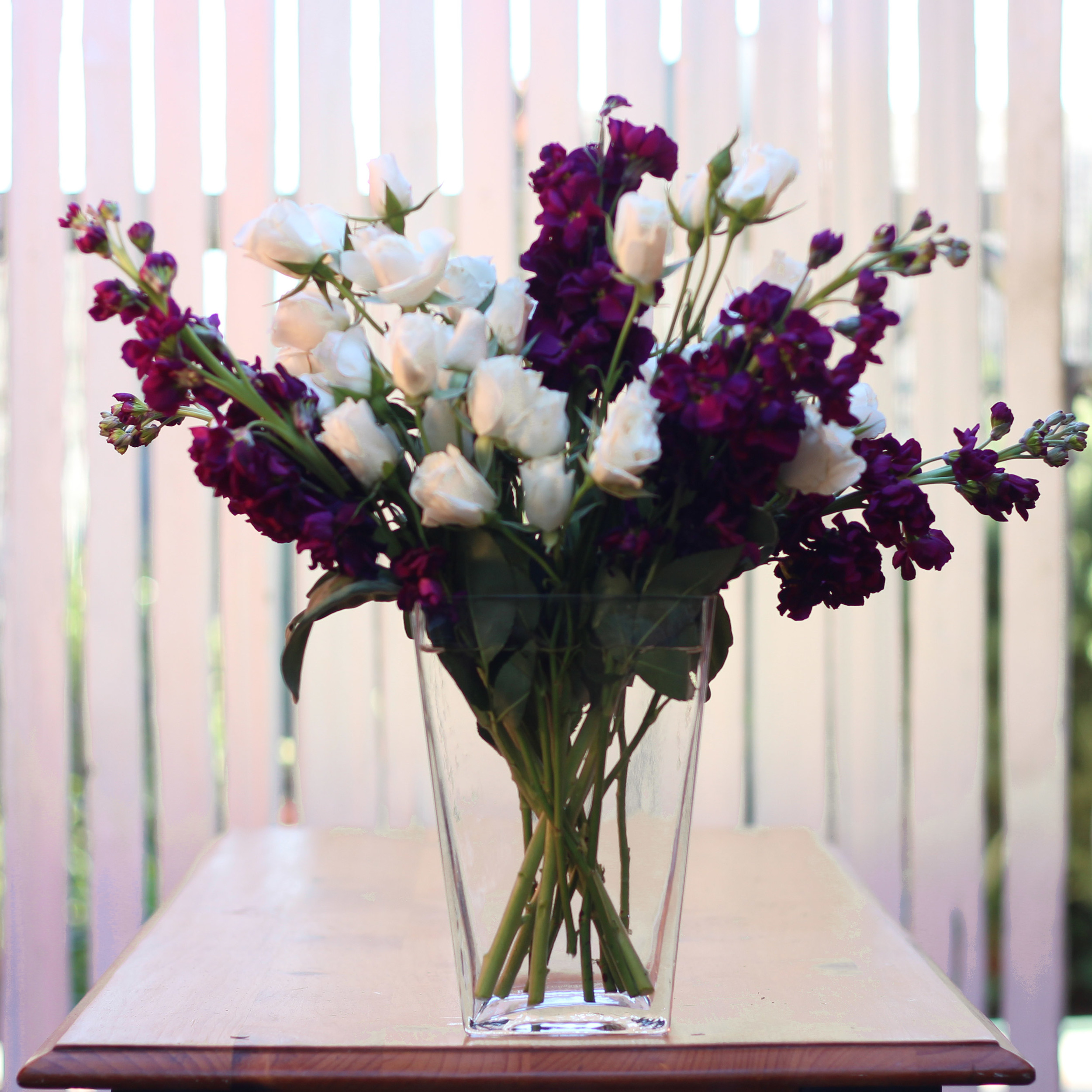 Fill in with Spray Roses, keeping stems in line with Stock stems.