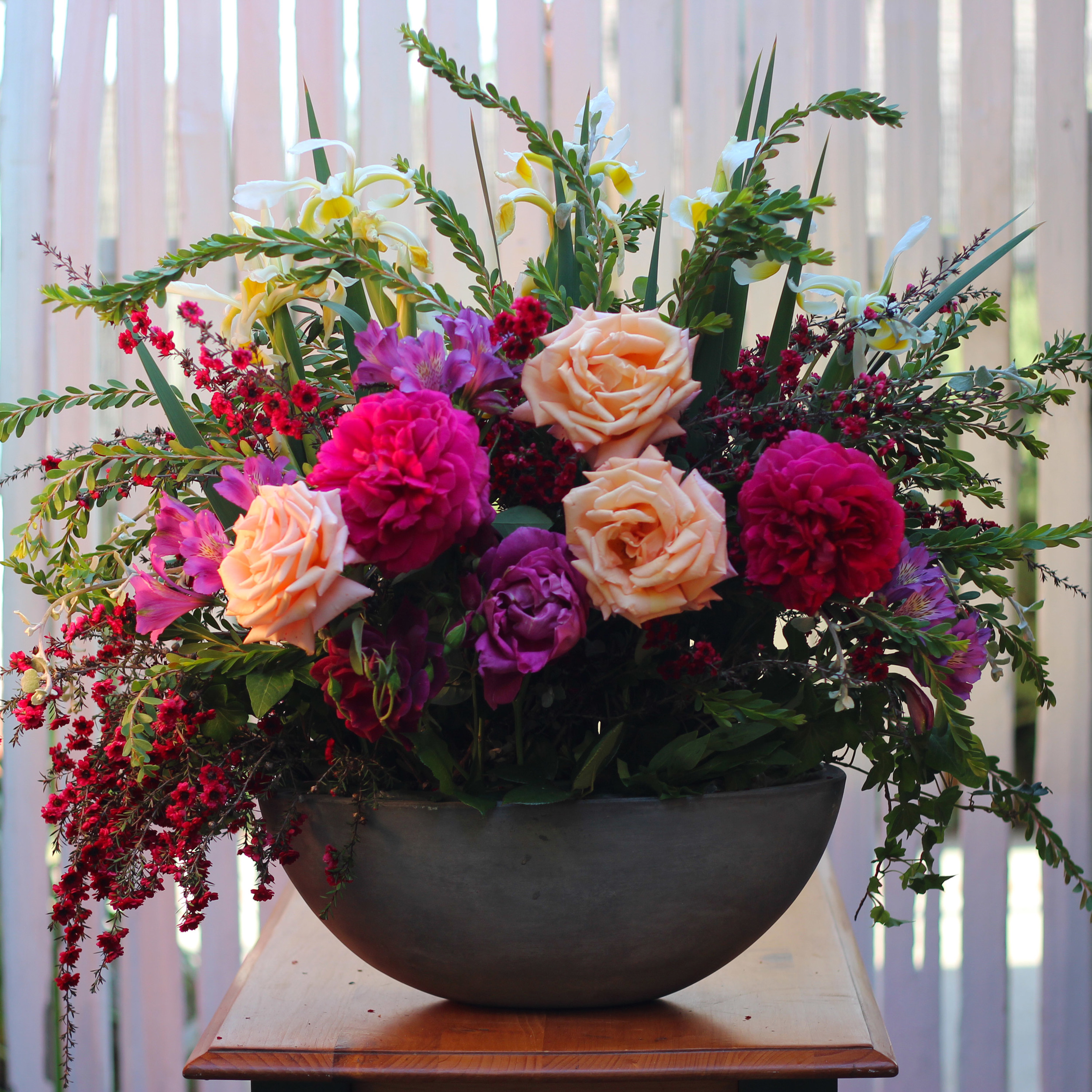 Add lavender roses low and lavender alstroemeria  in an arch above the roses in front.