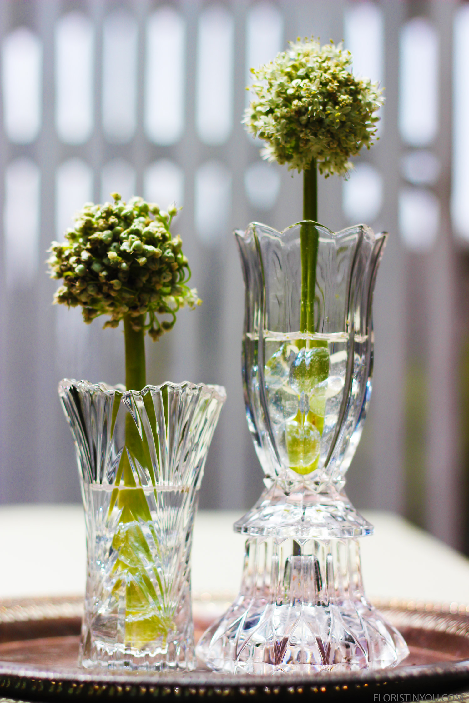 Put one vase on top of a crystal candlestick holder to give it some extra height. 'Cheating...cheating....hahaha.'