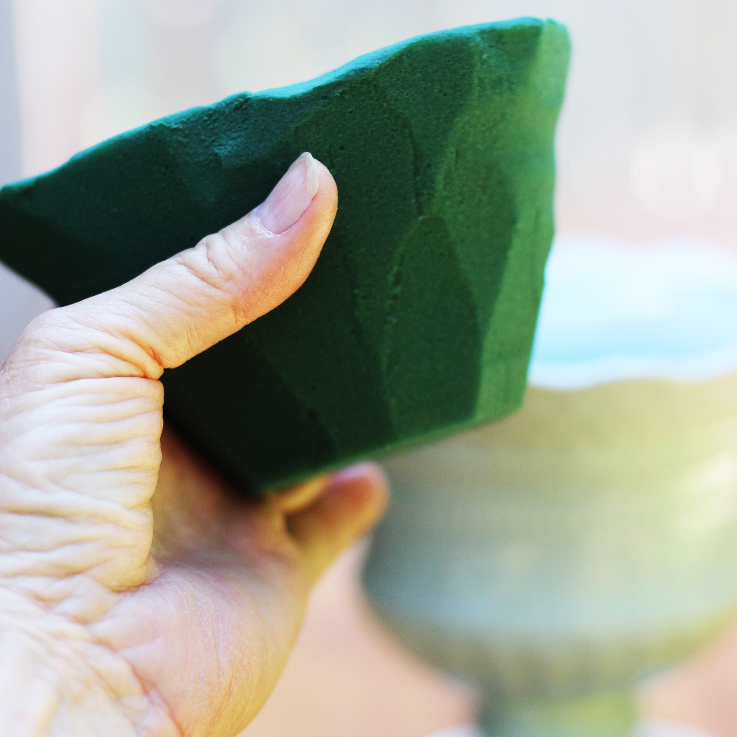 Shape your floral foam with a produce knife so it will fit into the vase.