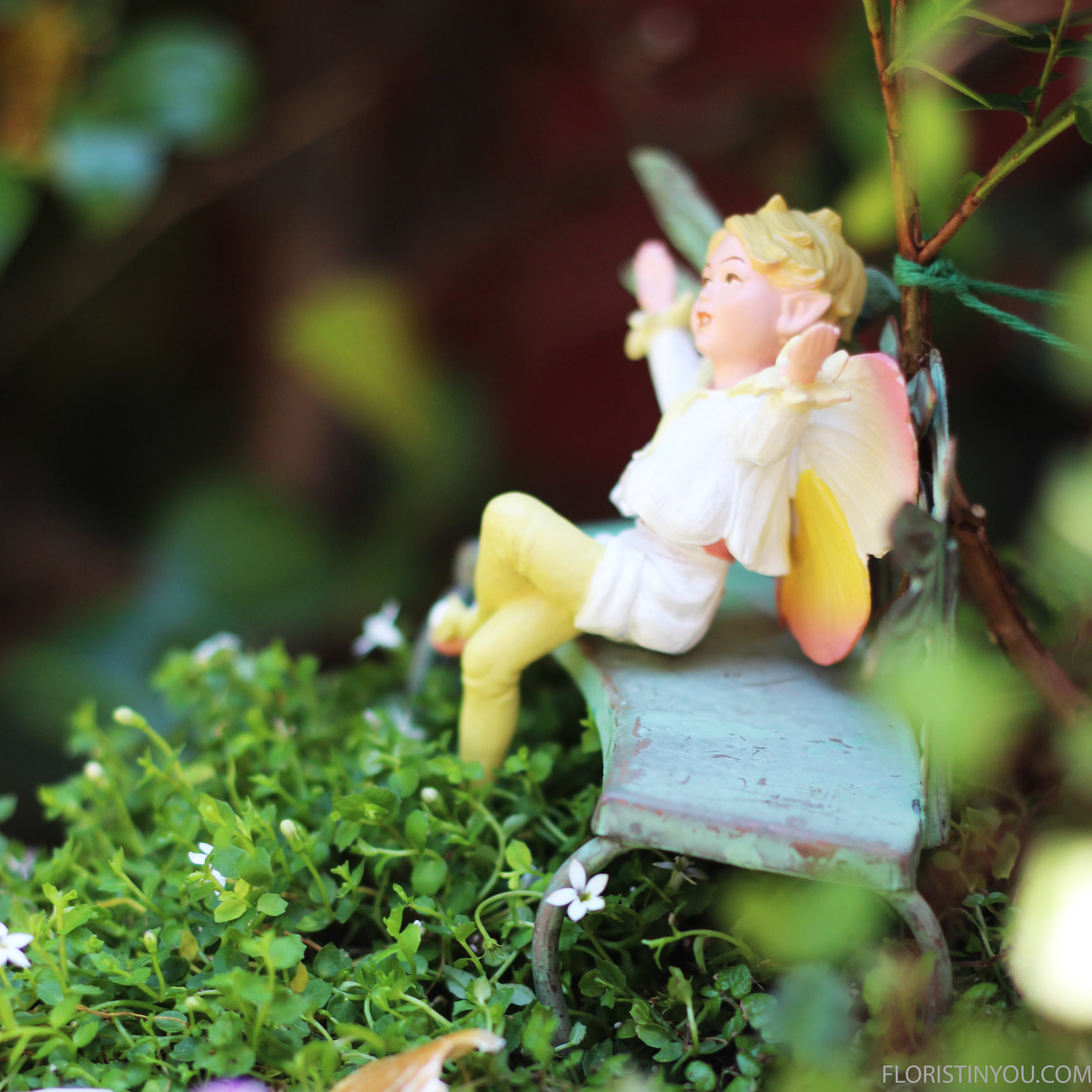 The Pear Blossom Fairie is right at home among the flowers.