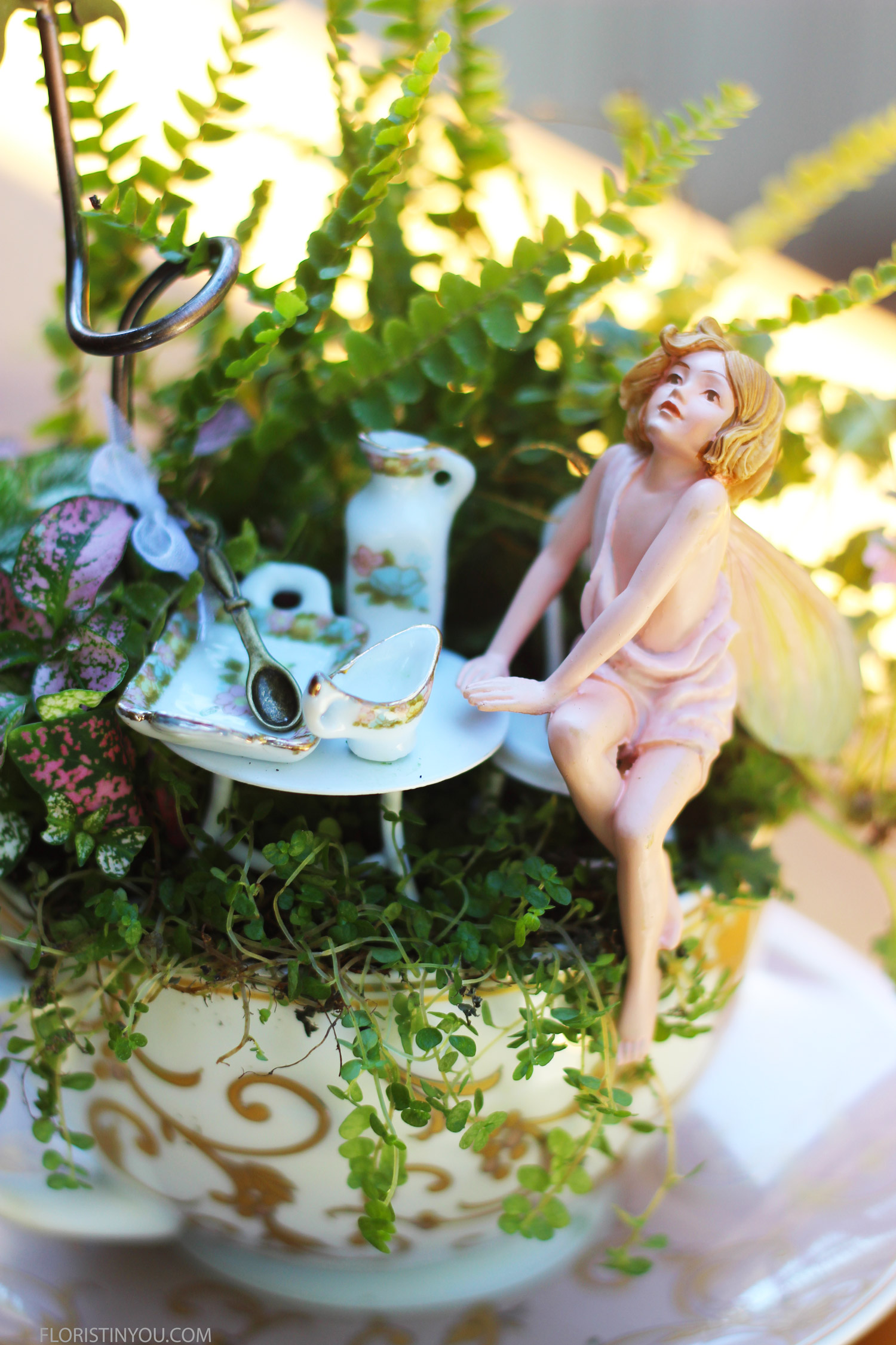 The light draws our attention to the delicate features of the Jasmine Fairy whom it seams is seated at a tea party in a fern graced wood. Enjoy this tiny fairy and her garden.