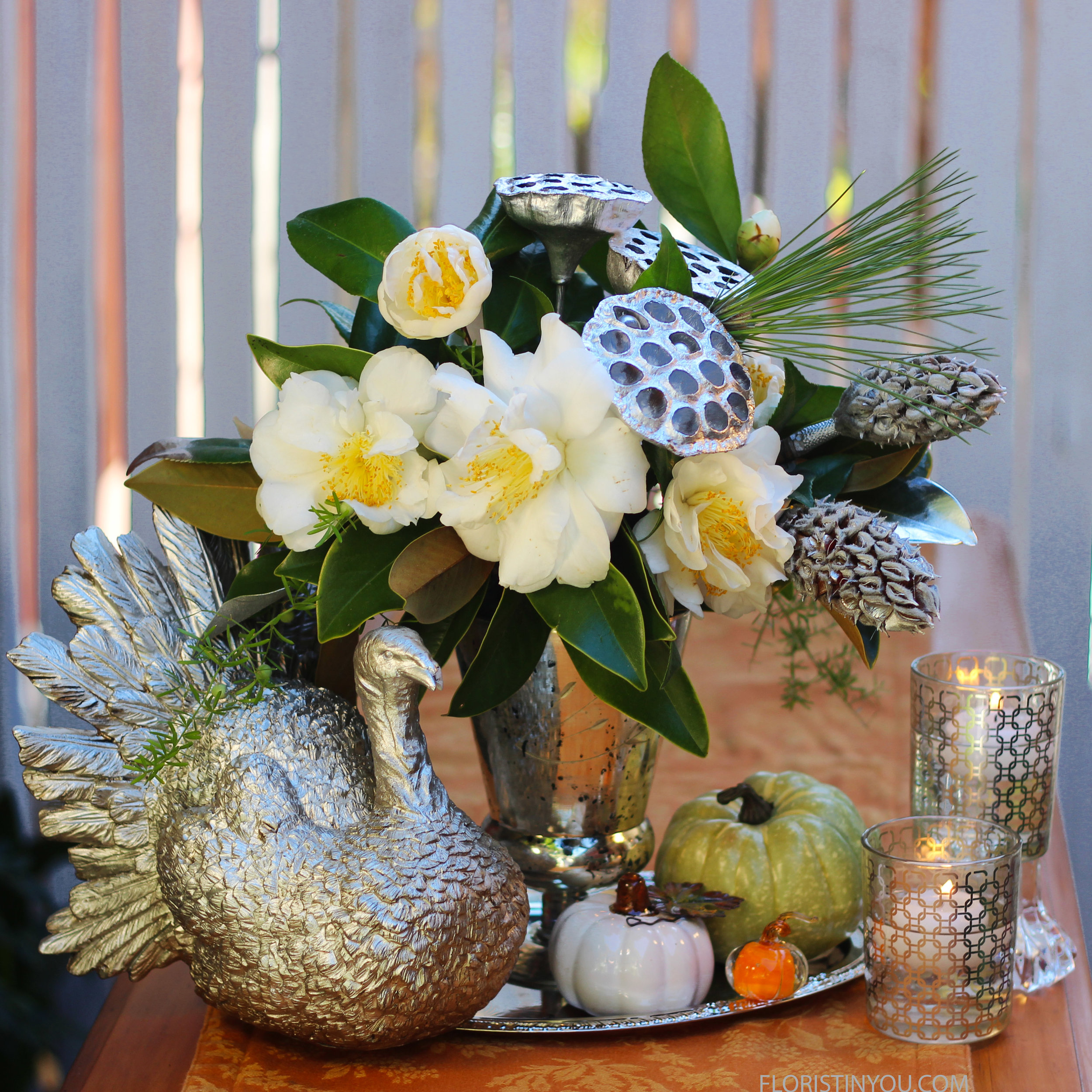 Add your silver turkey, pumpkins, tray,and silver patterned votives for your table setting.