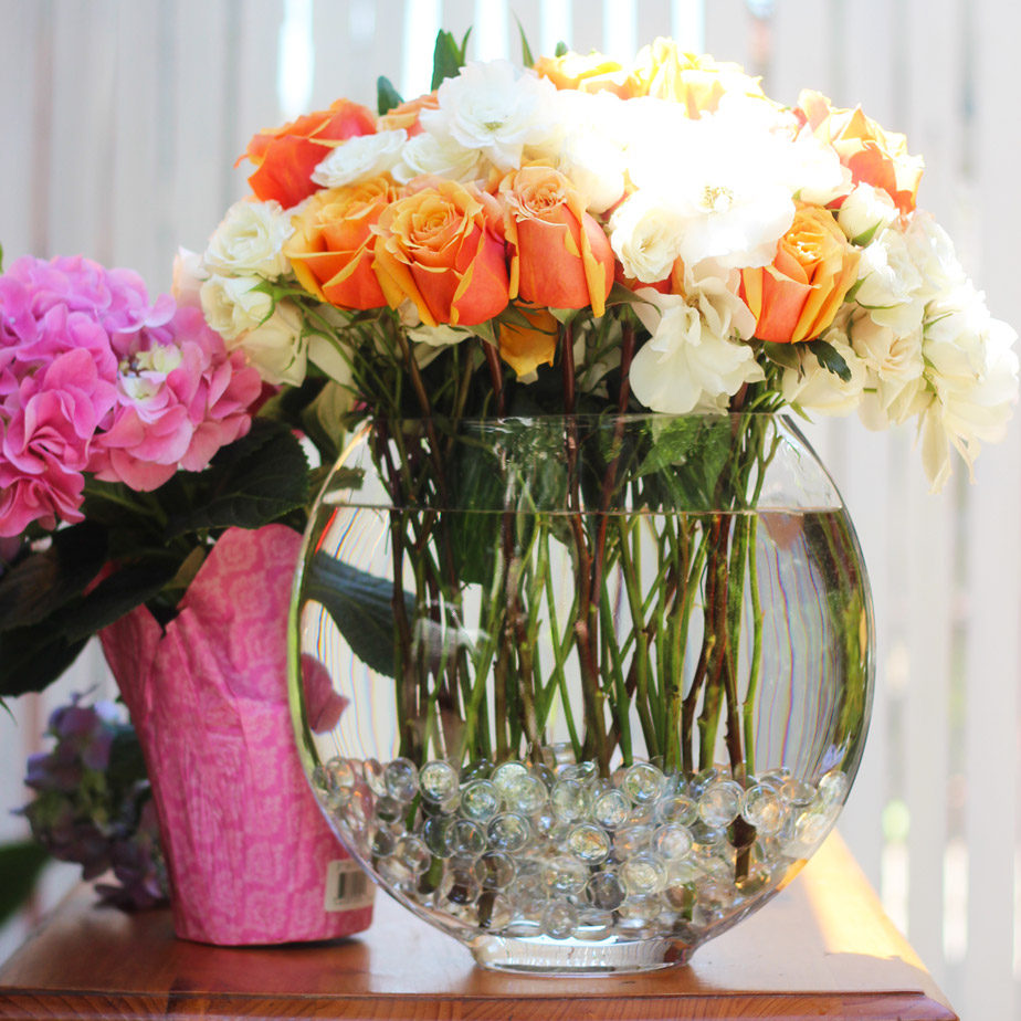 Wire roses and place among the Iceberg and Spray roses with stems going straight down.