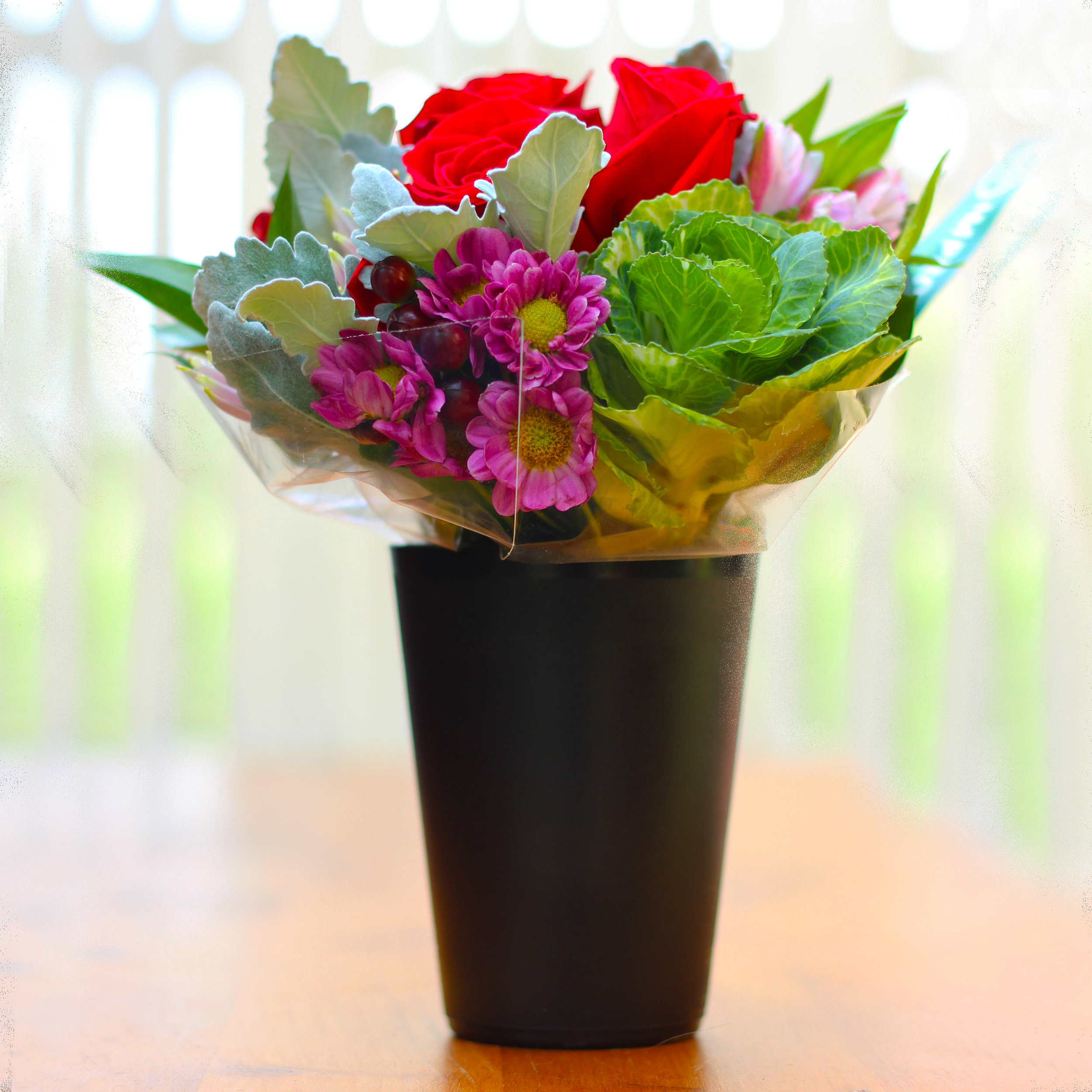 The bouquet comes in a little black platic cup.