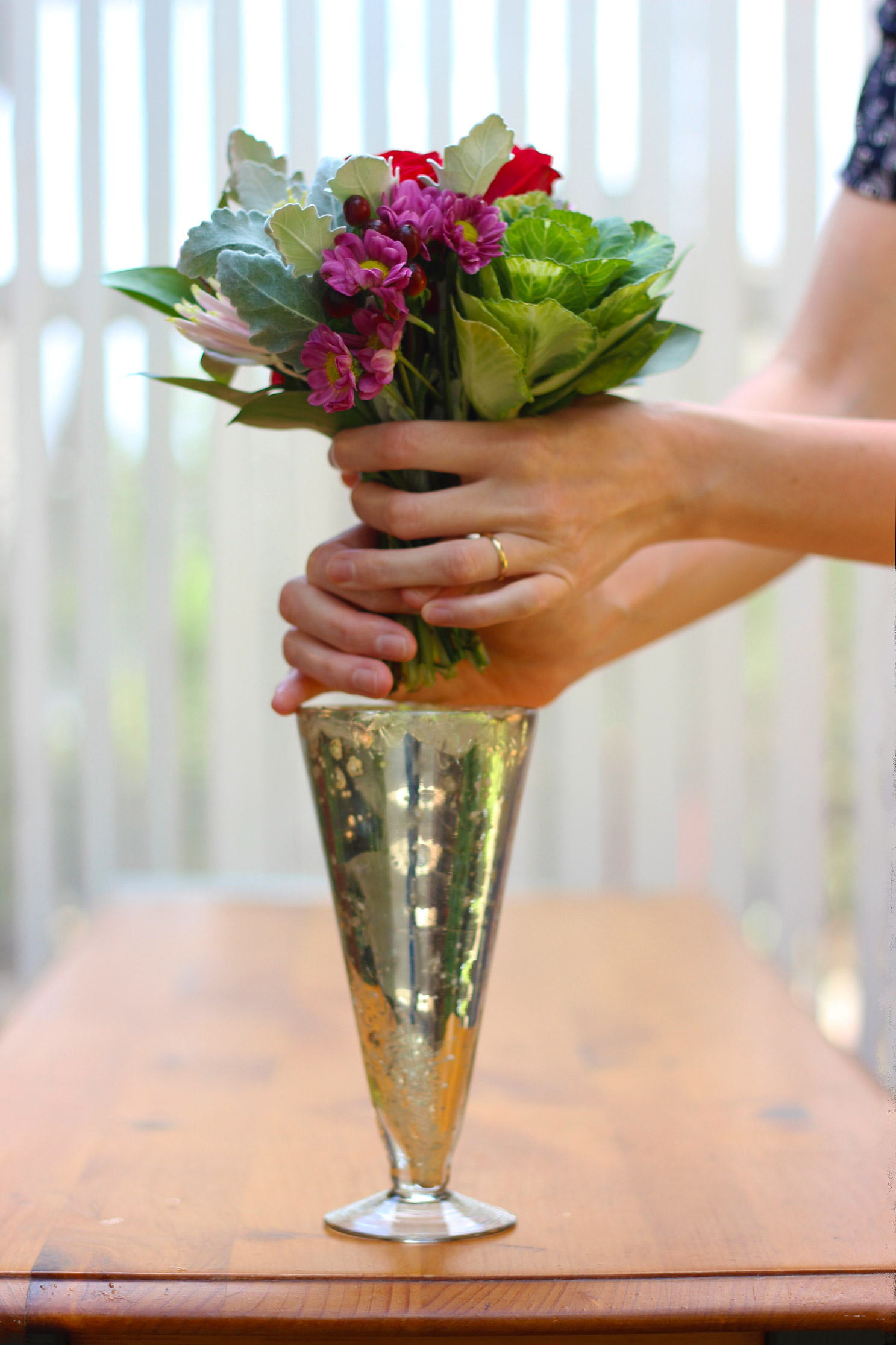 Keep bunch in place and slide into vase.