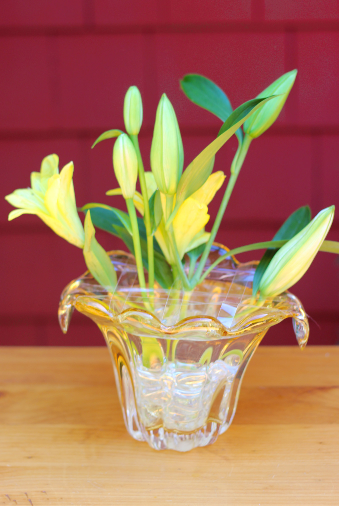 For this size vase, Re-cut lilies to 10.5 inches on 45 degree angle. Insert. It's OK to lift tape.