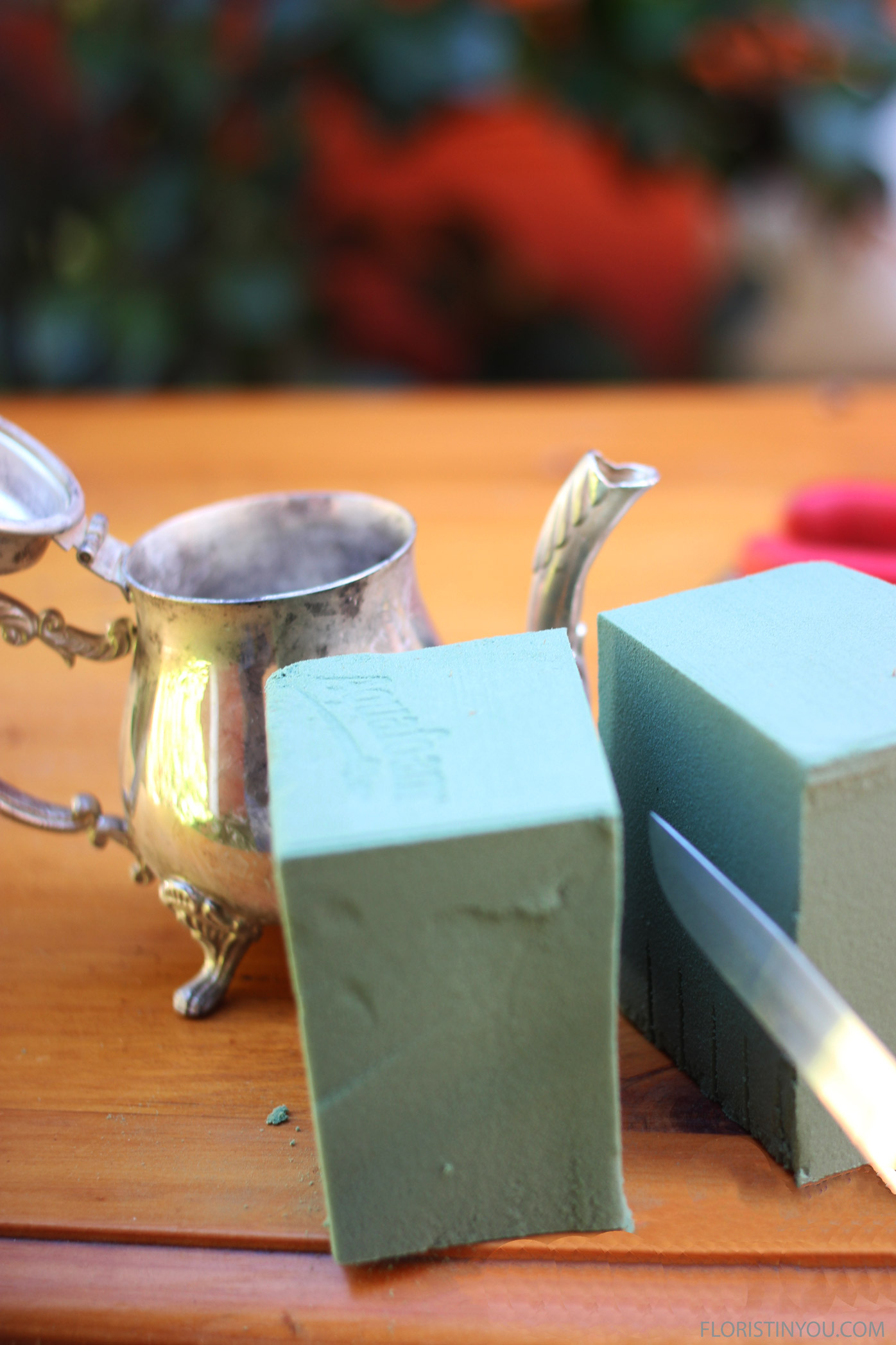 Cut last 1/3 of brick in half and shape for tiny tea pot.