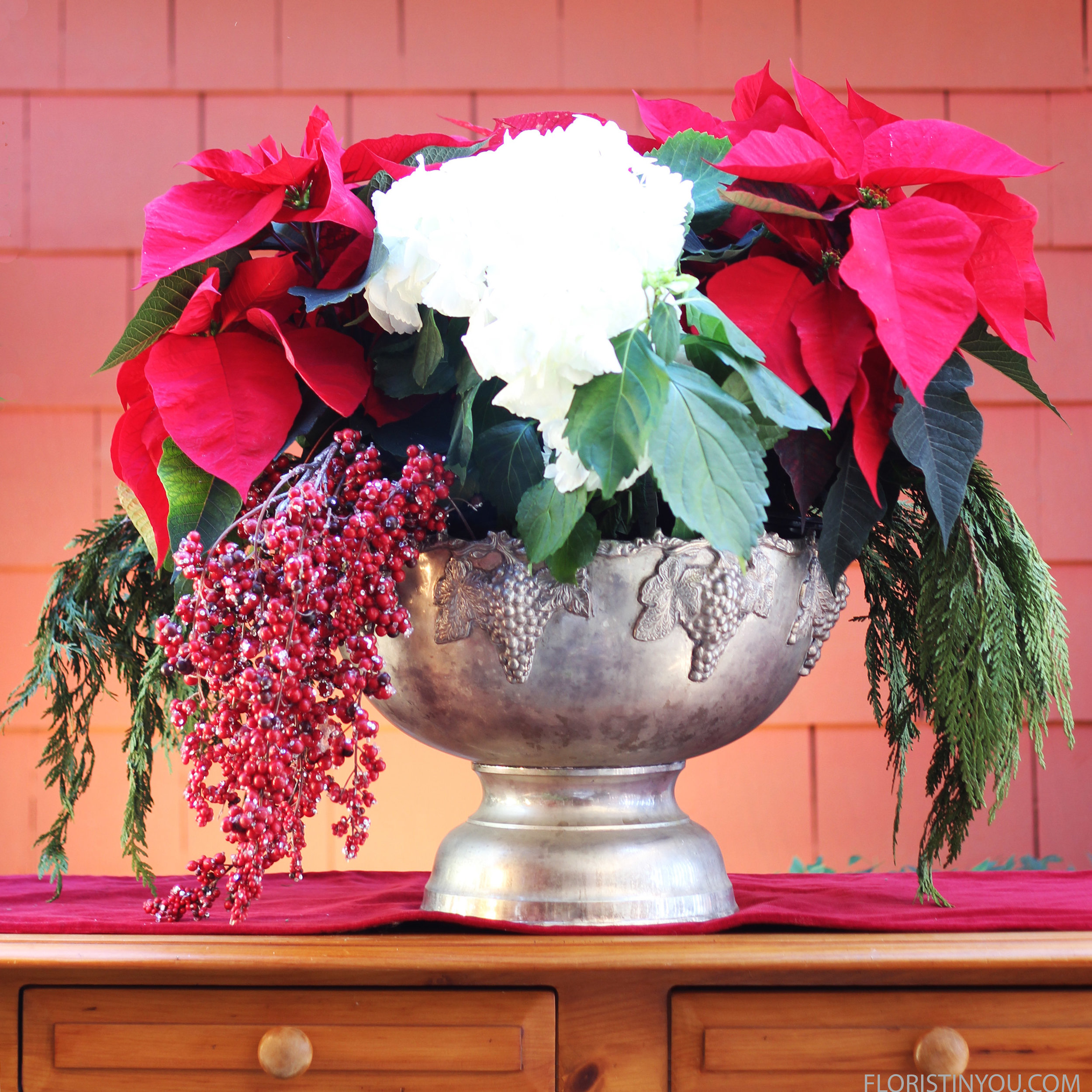 Put faux berries in on a 45 degree angle to the left of the Hydrangea.