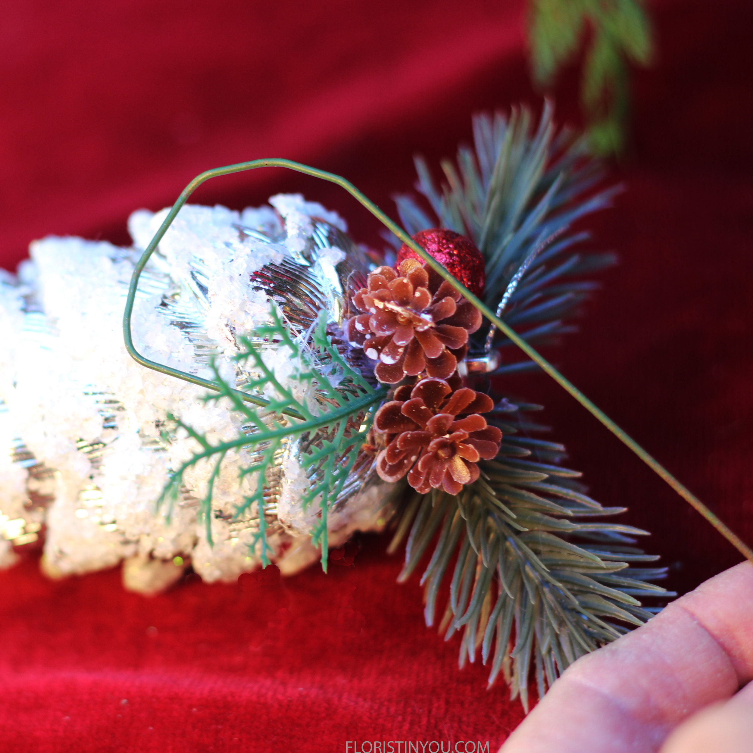 Wrap 8 inch wire around top of pine cone.