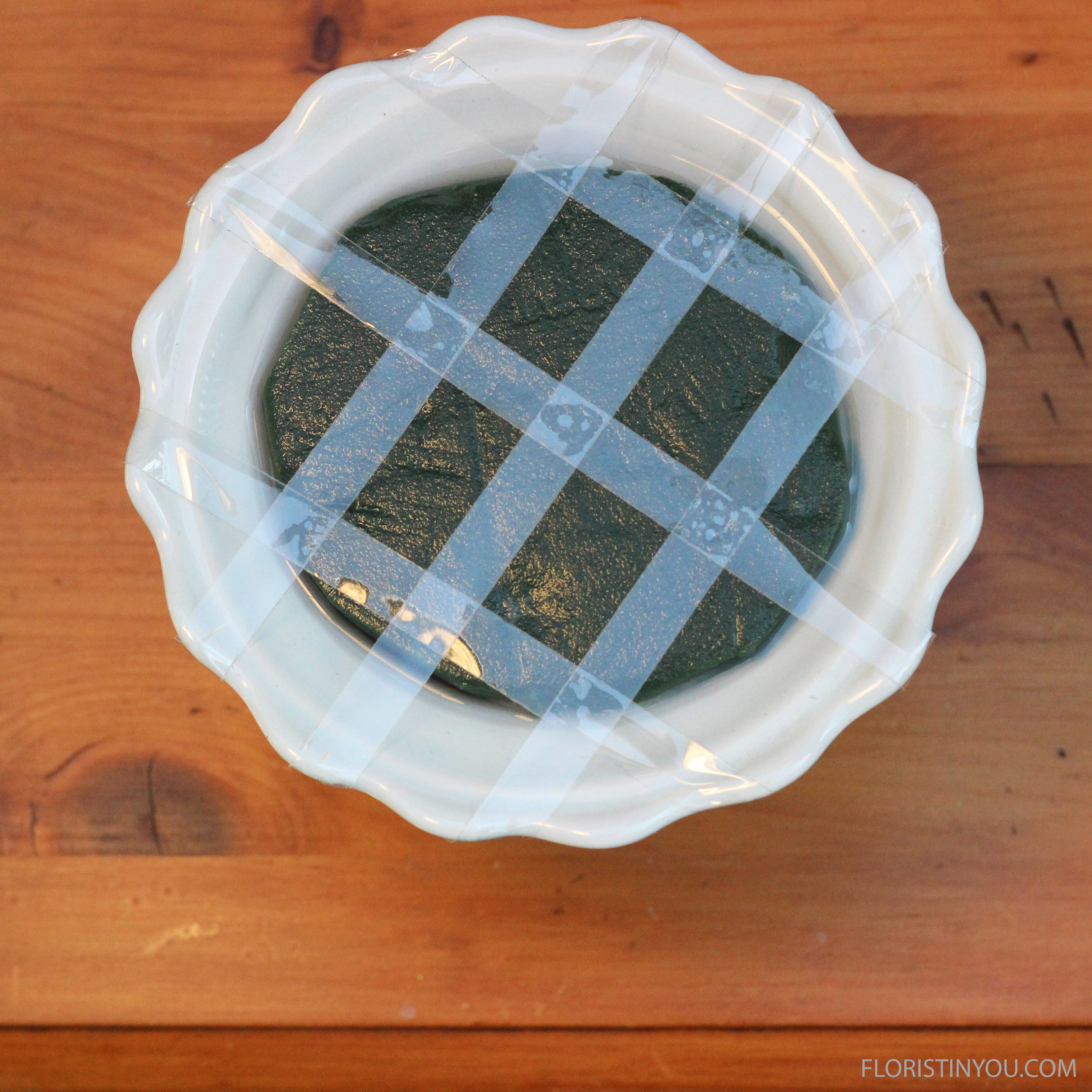 Make sure rim is dry and make grid out of waterproof tape, sticking tape to rim.