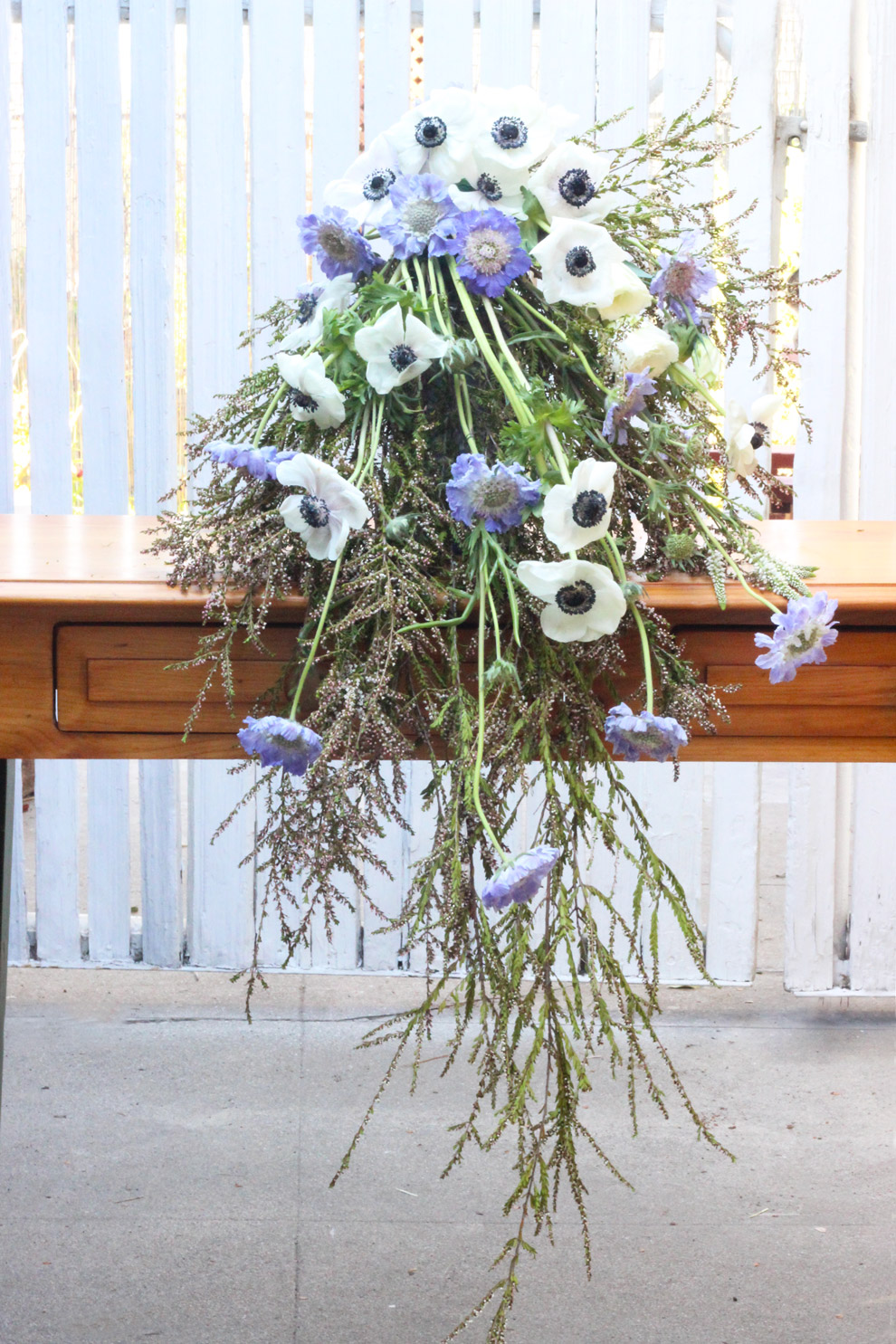 Add Anemones and blue Scabiosa down the front.