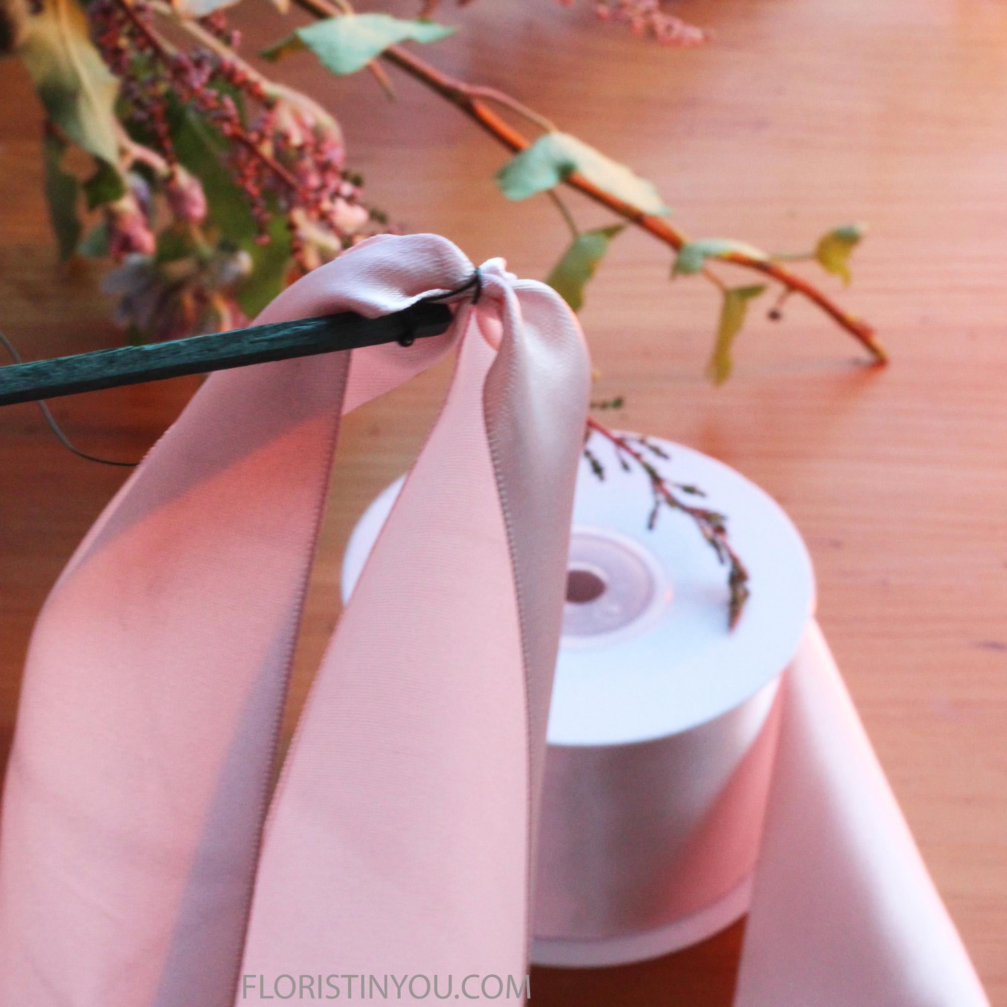 Wrap pick wire around ribbon at half way point.