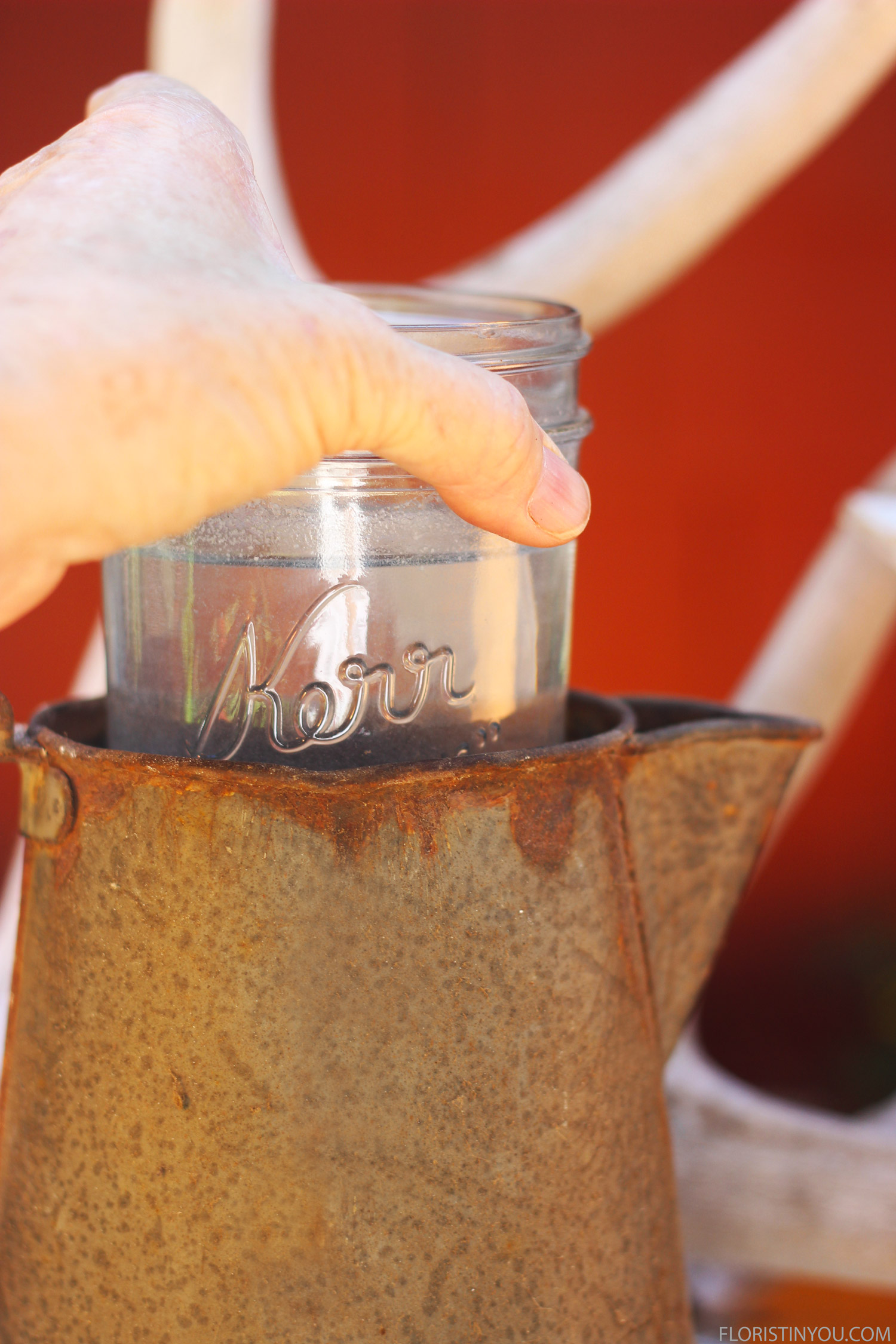 Slide the mason jar into the container.