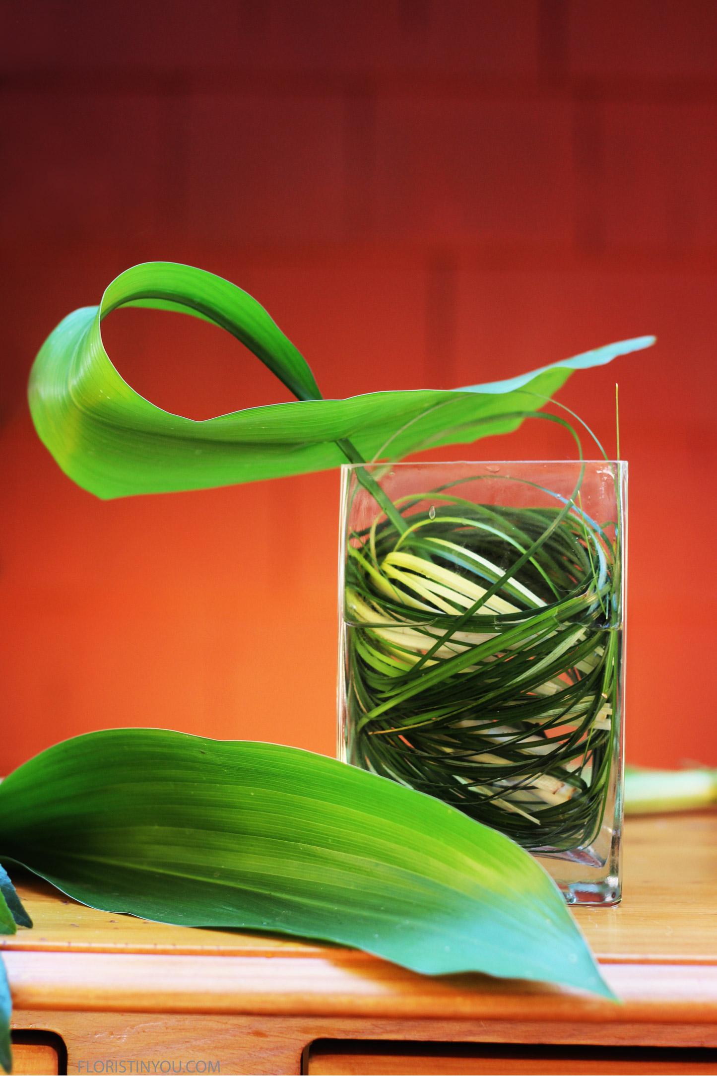 Put pierced Tea Leaf on the left side of the vase.