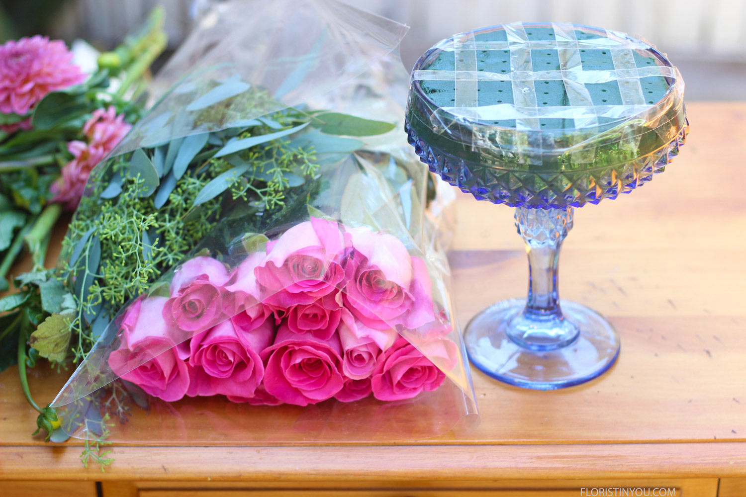 Fit 2 half circles foam into vase.  Wipe off rim.  Make tape grid with water proof tape.  Then tape all the way around rim.
