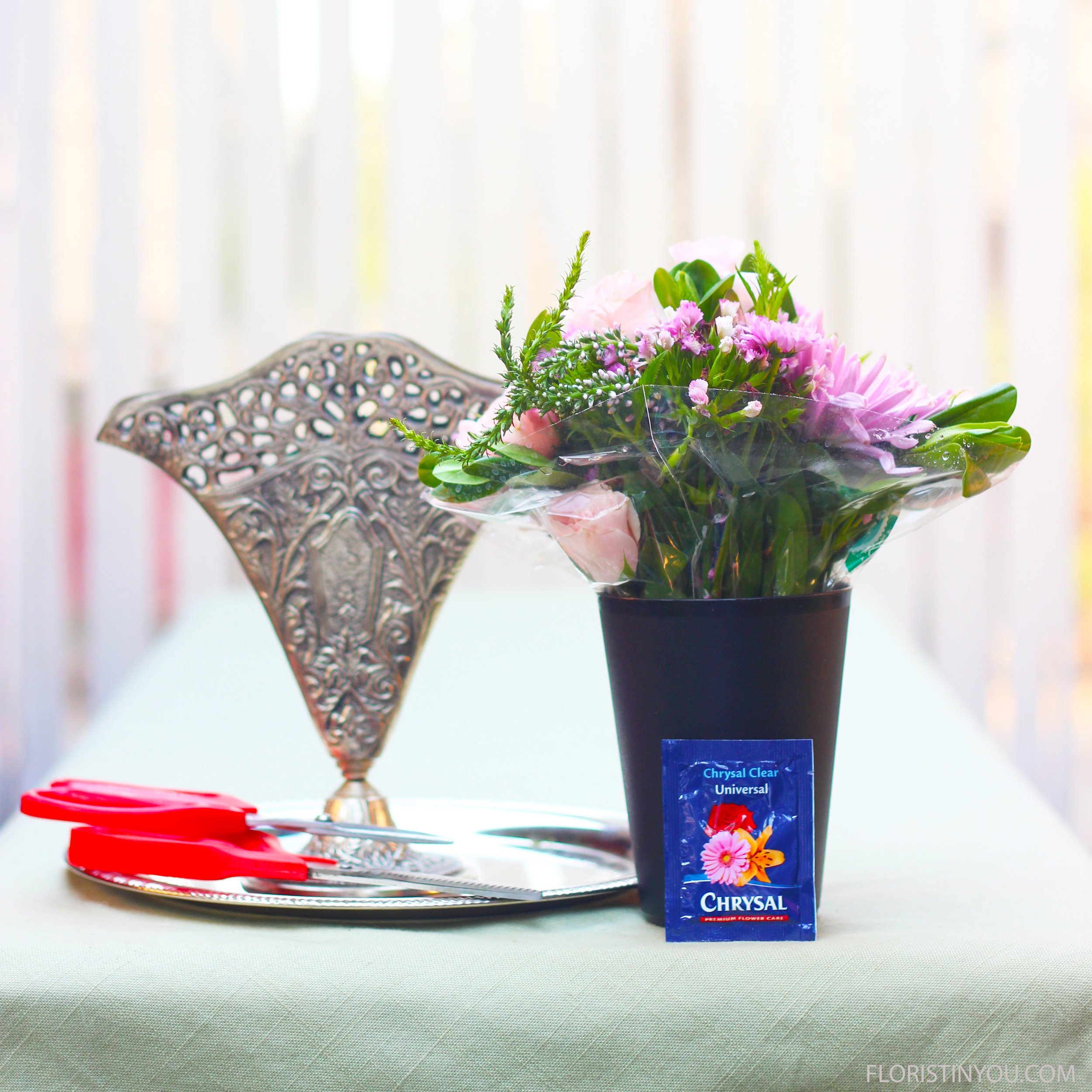 Here are your flowers, vase and materials.