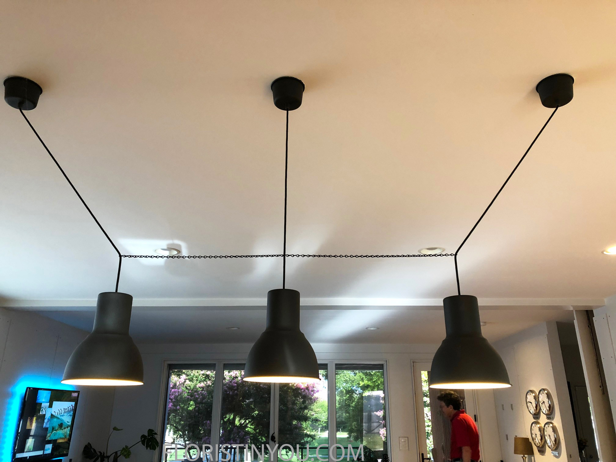 These pendants hang over the dining table with the MoMA vase.