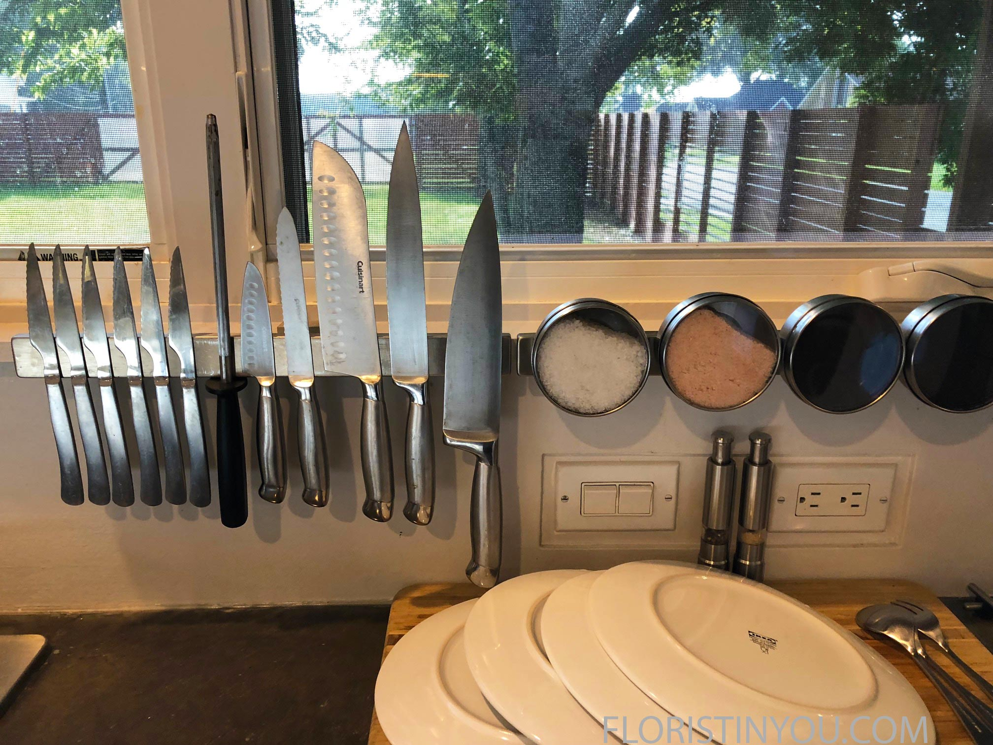 This is a magnetic knife rack which also houses different gourmet salts.