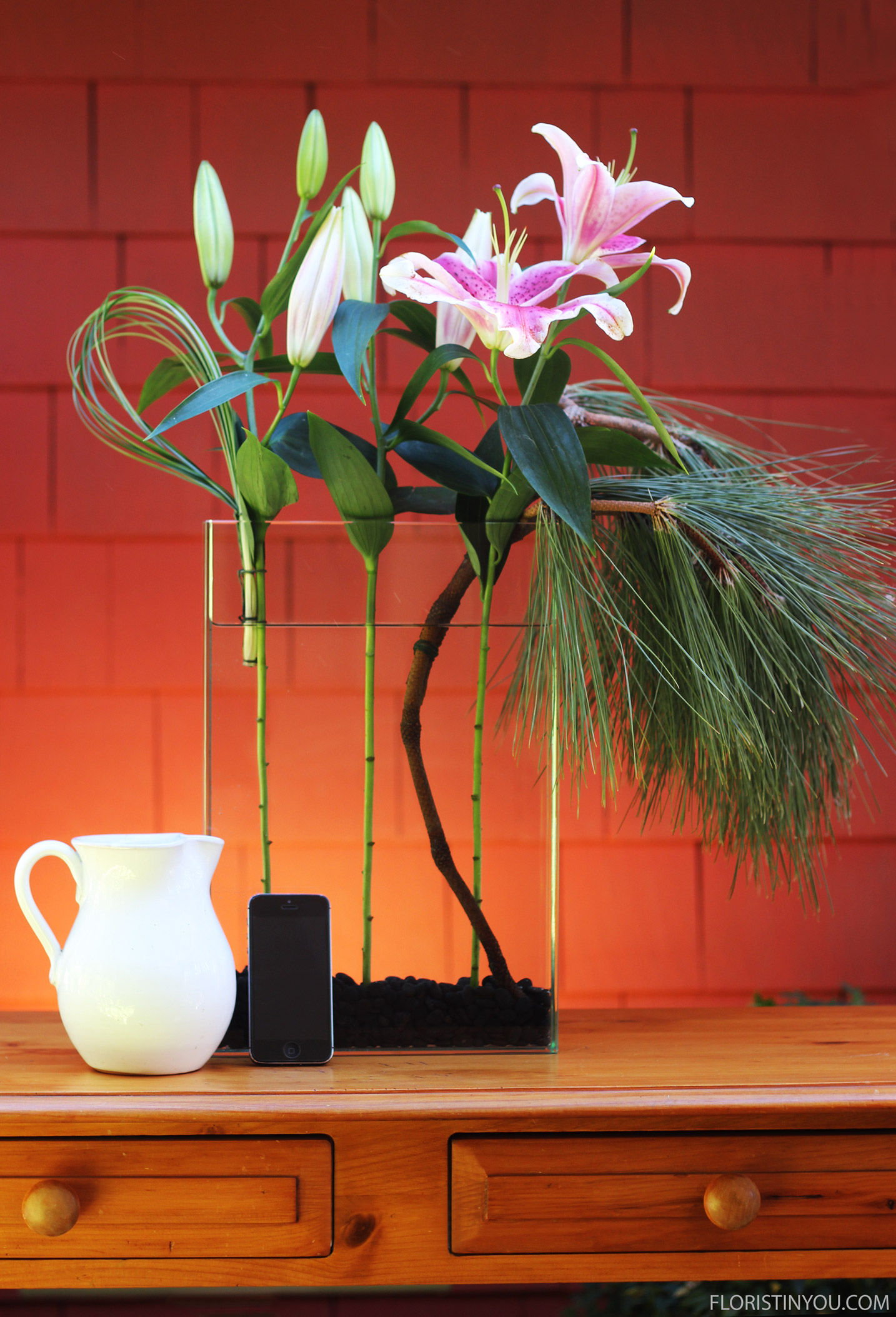 See the scale of the arrangement next to a cell phone and a pitcher.