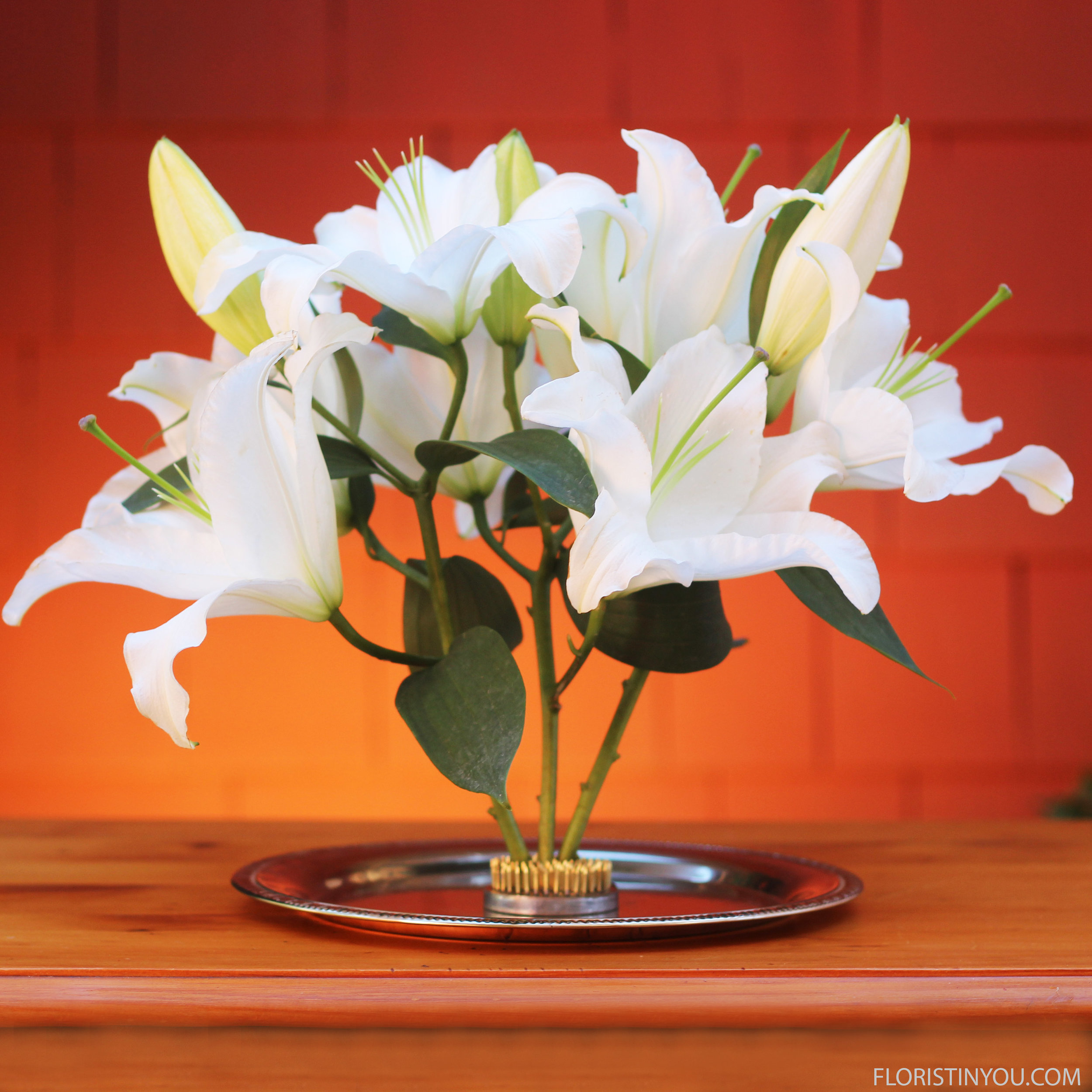 Push stems into floral frog in the way you want them arranged.