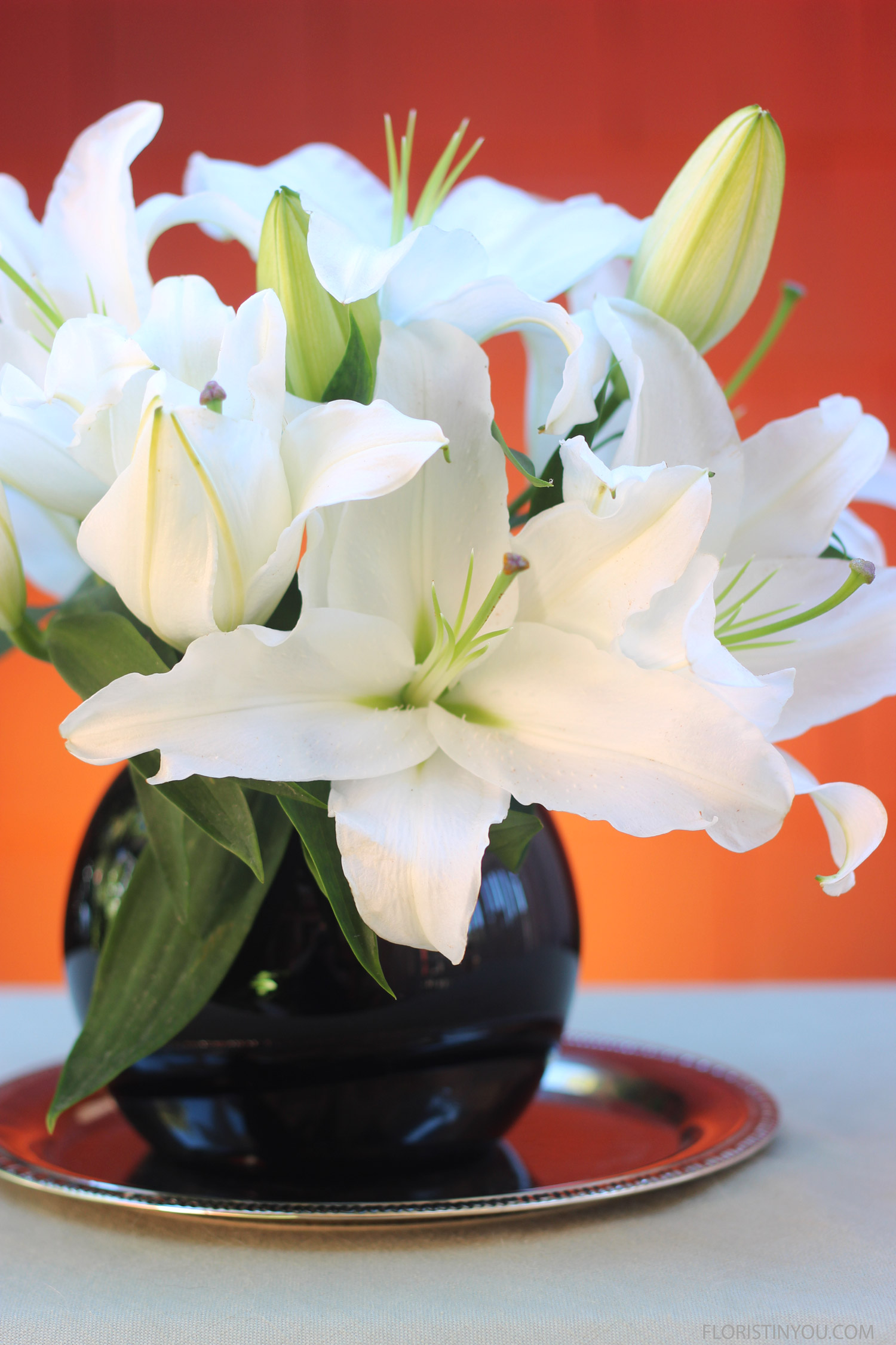 The closed lilies will open up over the next few days.