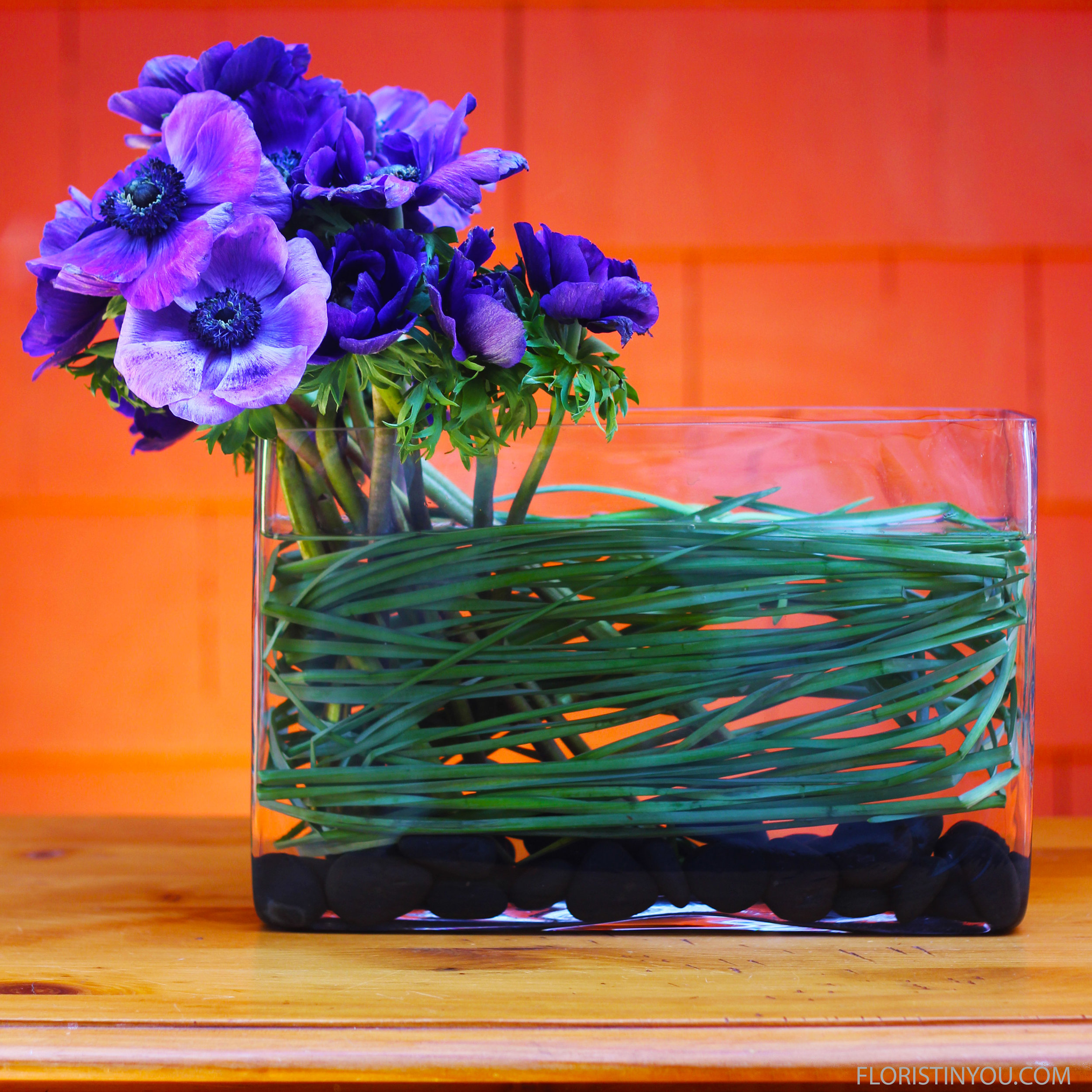 Place purple Anemones on left side of vase.