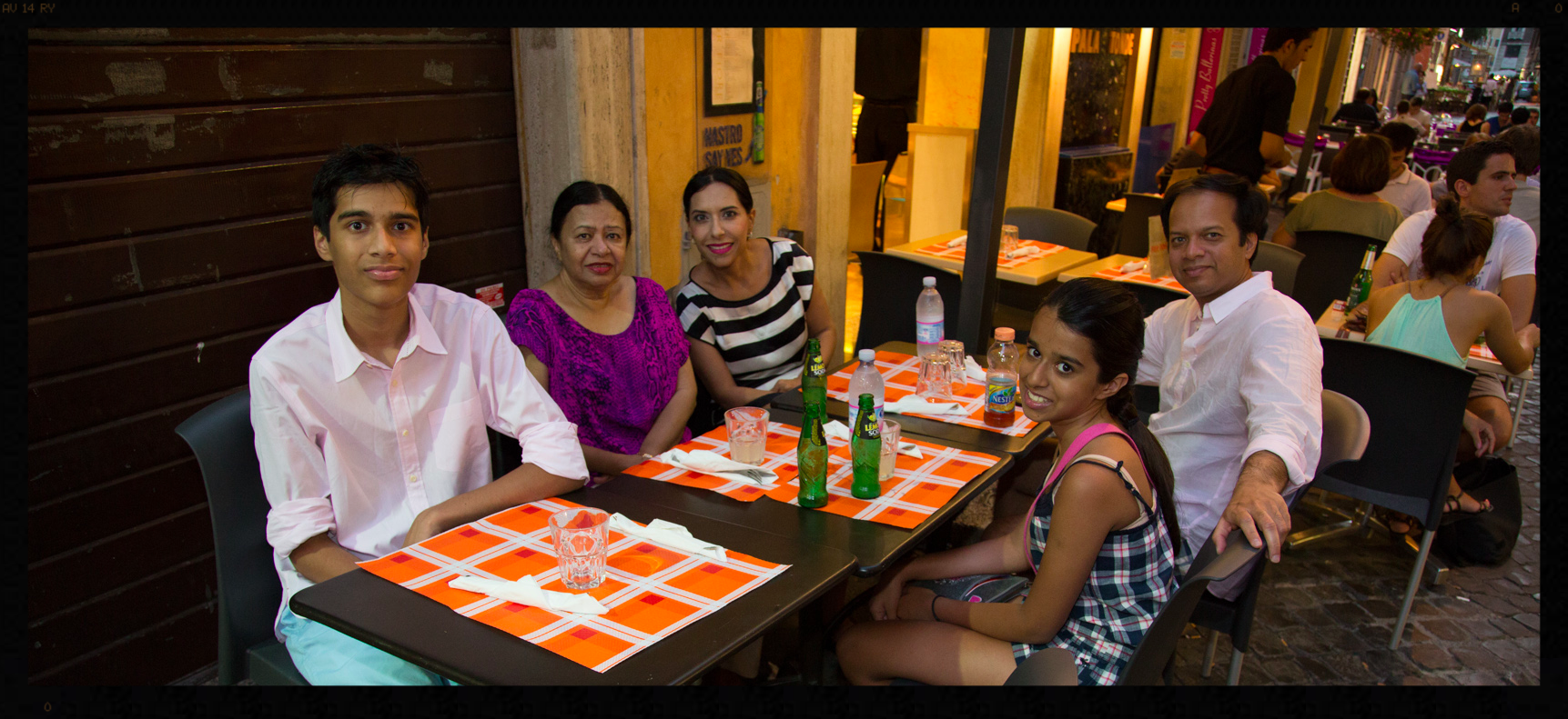 Family having dinner in Rome
