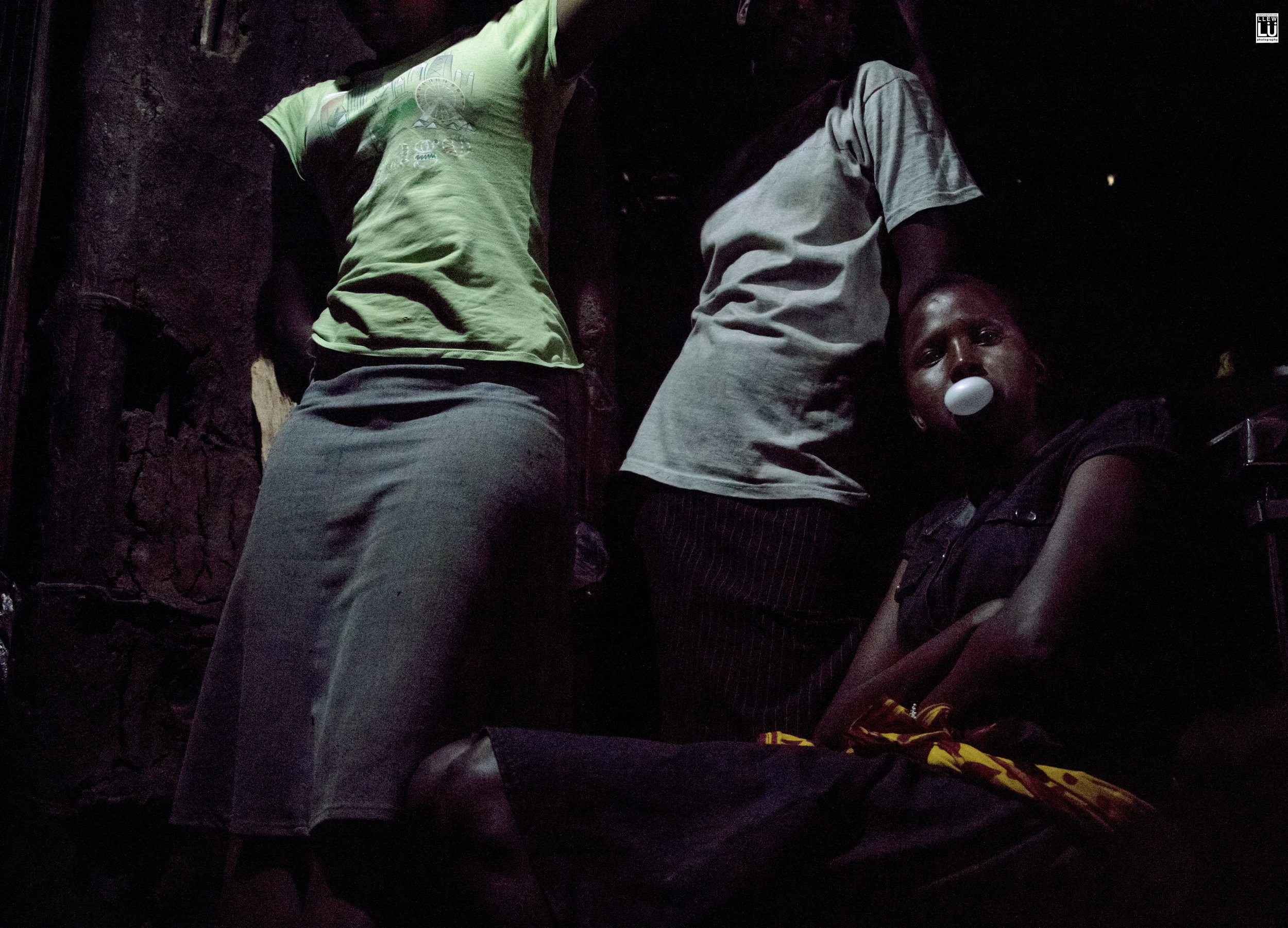 I was invited in to hang out with some young ladies. The inside of an Enkai is really small, warm and dark. It smells strongly of wood burning from the small stove that vents through the only small hole that natural light flows through.